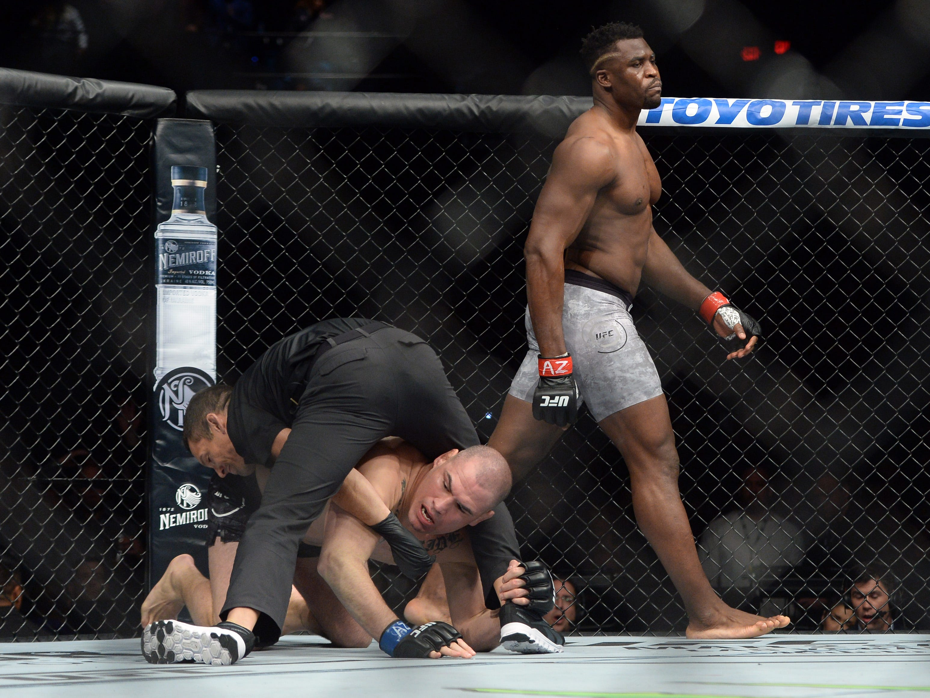Francis Ngannou walks away after finishing Cain Velasquez  just 26 seconds into the first round of their heavyweight fight at UFC on ESPN at Talking Stick Resort Arena.