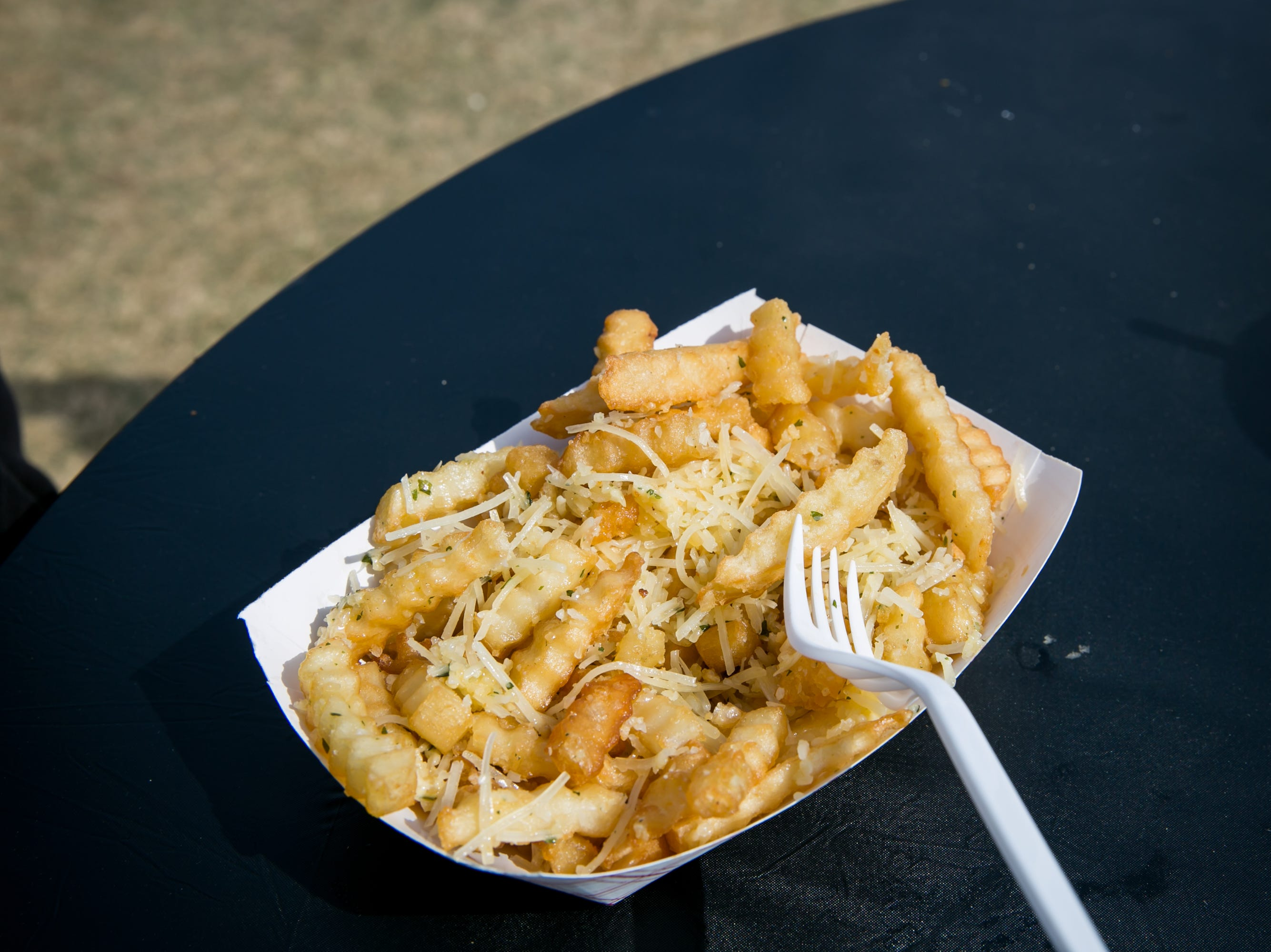 Burgers Amore's garlic fries with Parmesan were delicious during the Street Eats Food Truck Festival at Salt River Fields near Scottsdale on Feb. 17, 2019.