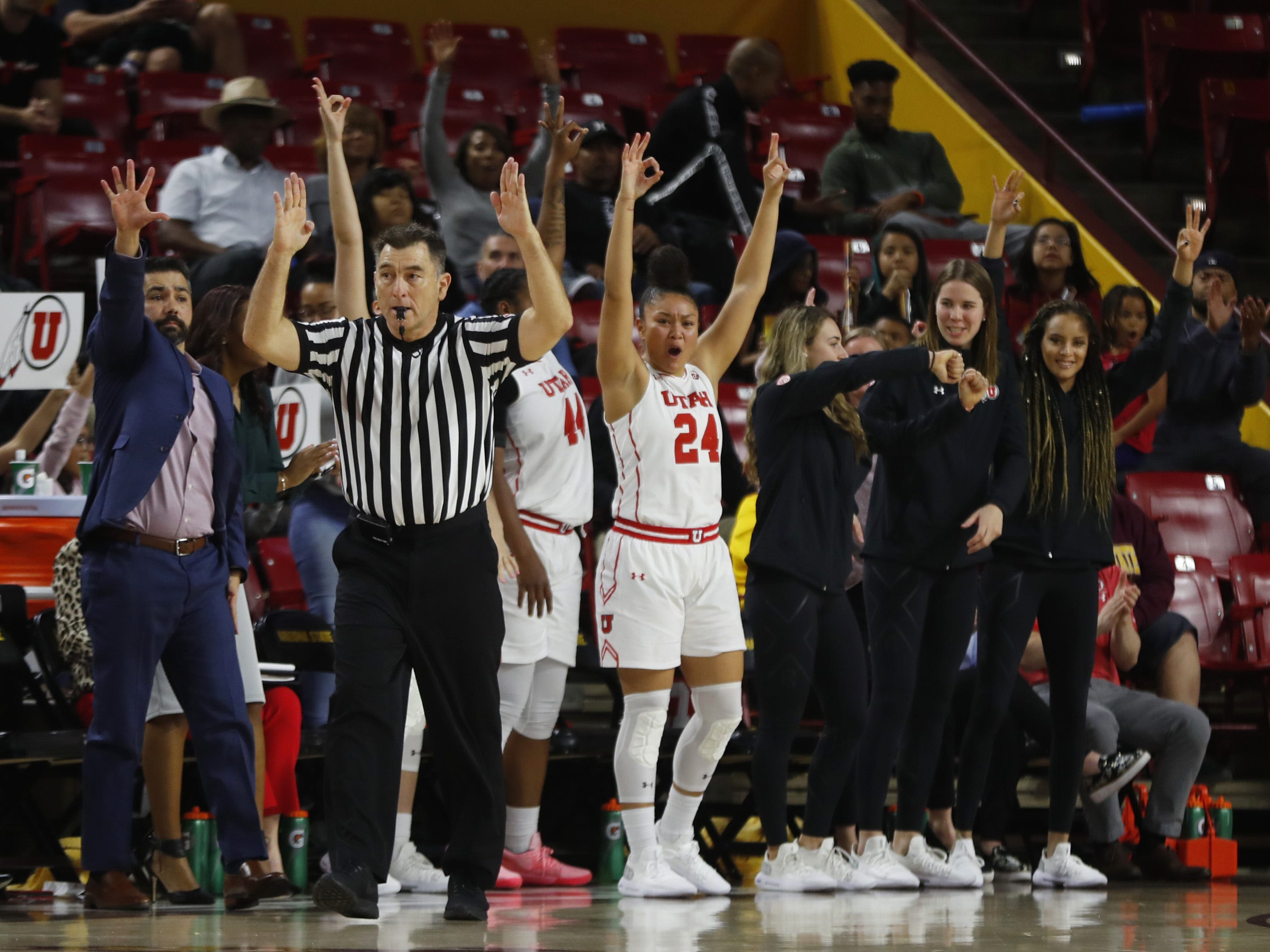 Utah's bench erupts after a three puts them up 17 over the Sun Devils during the second half at Wells Fargo Arena in Tempe, Ariz. on February 17, 2019.