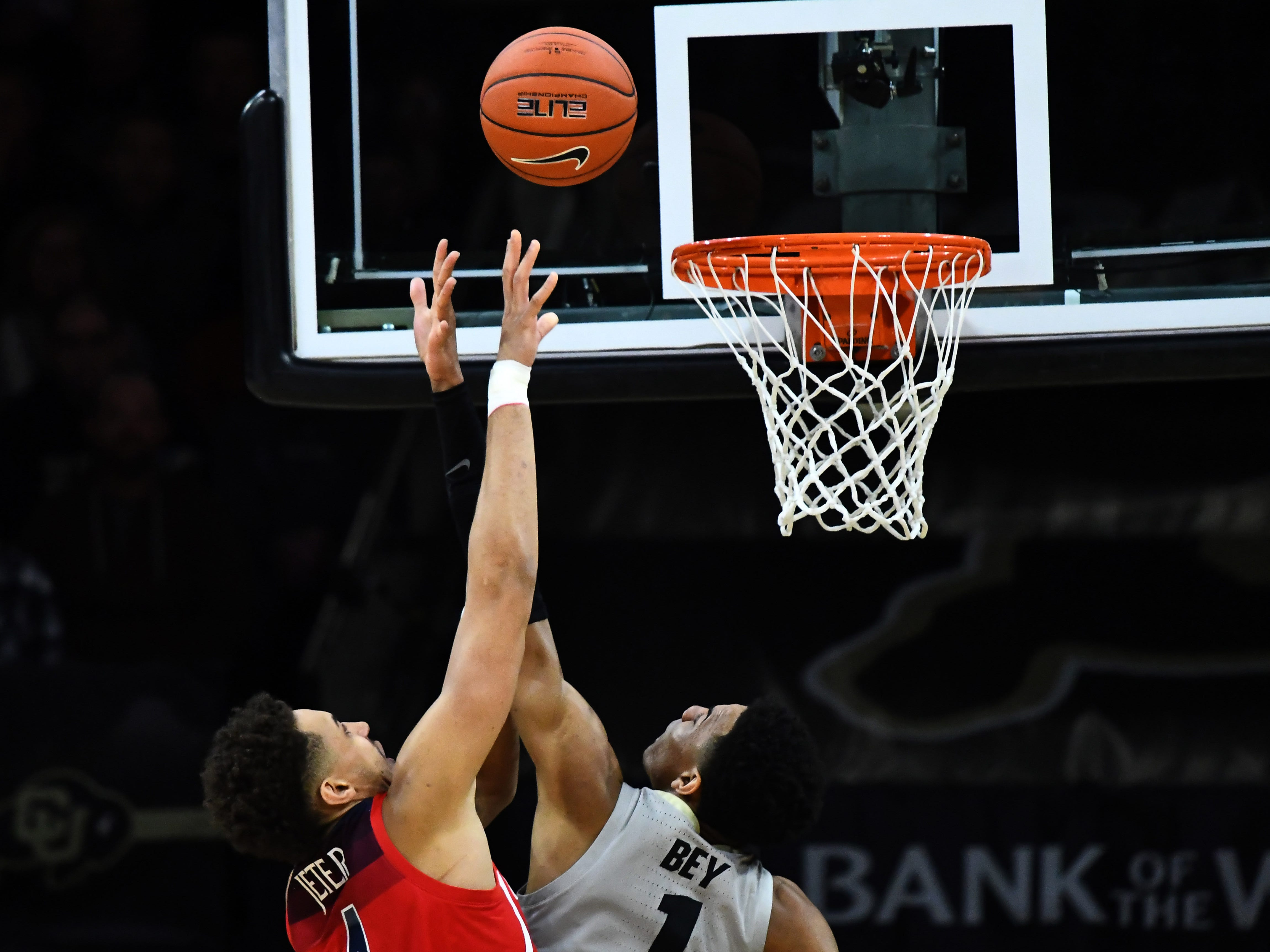 Feb 17, 2019; Boulder, CO, USA; Arizona Wildcats center Chase Jeter (4) shoots over Colorado Buffaloes guard Tyler Bey (1) in the first half at the Coors Events Center. Mandatory Credit: Ron Chenoy-USA TODAY Sports
