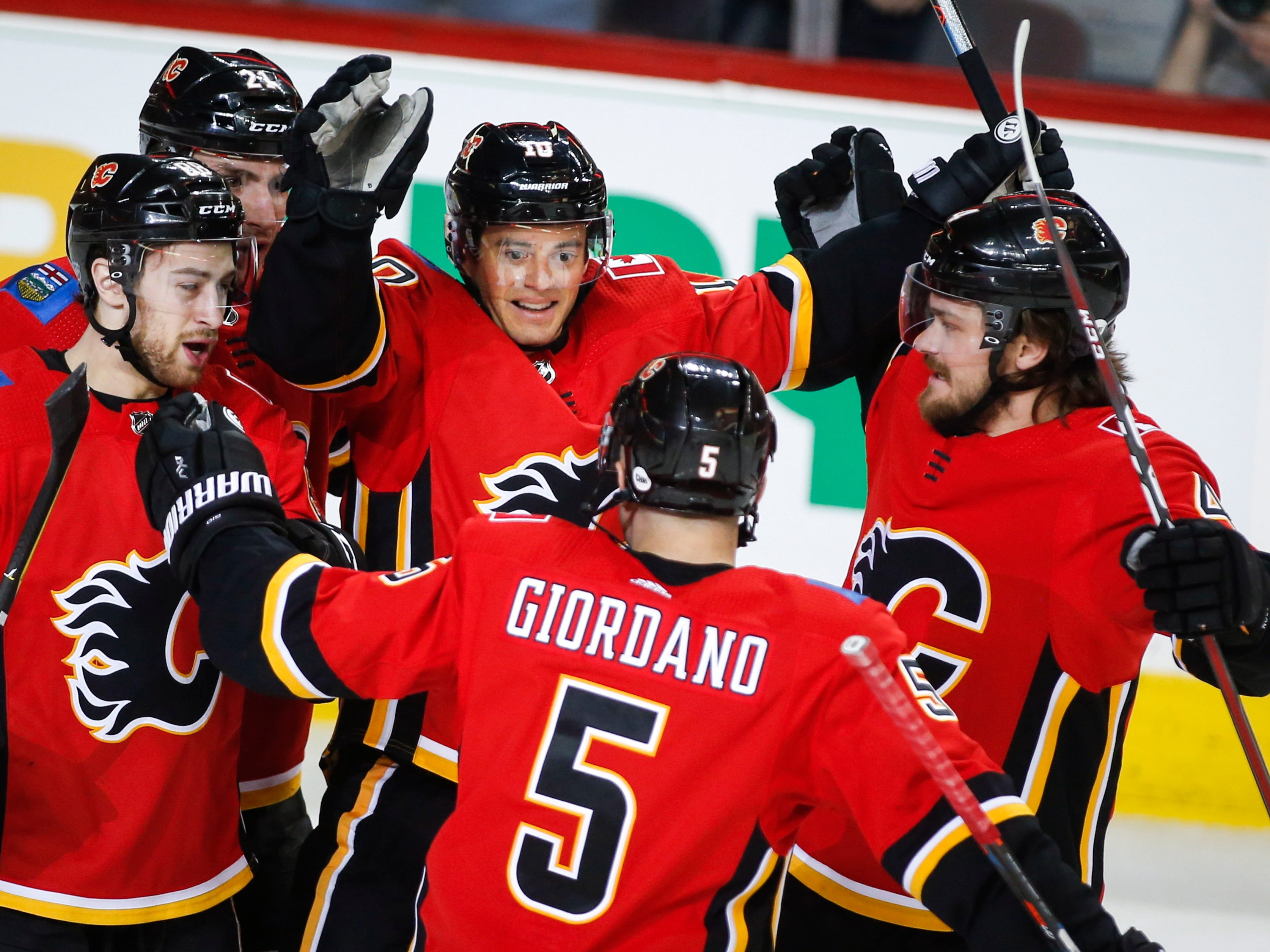 Calgary Flames' Derek Ryan (10) celebrates his goal with teammates during first period NHL hockey action against the Arizona Coyotes in  Calgary, Alberta, Monday, Feb. 18, 2019.