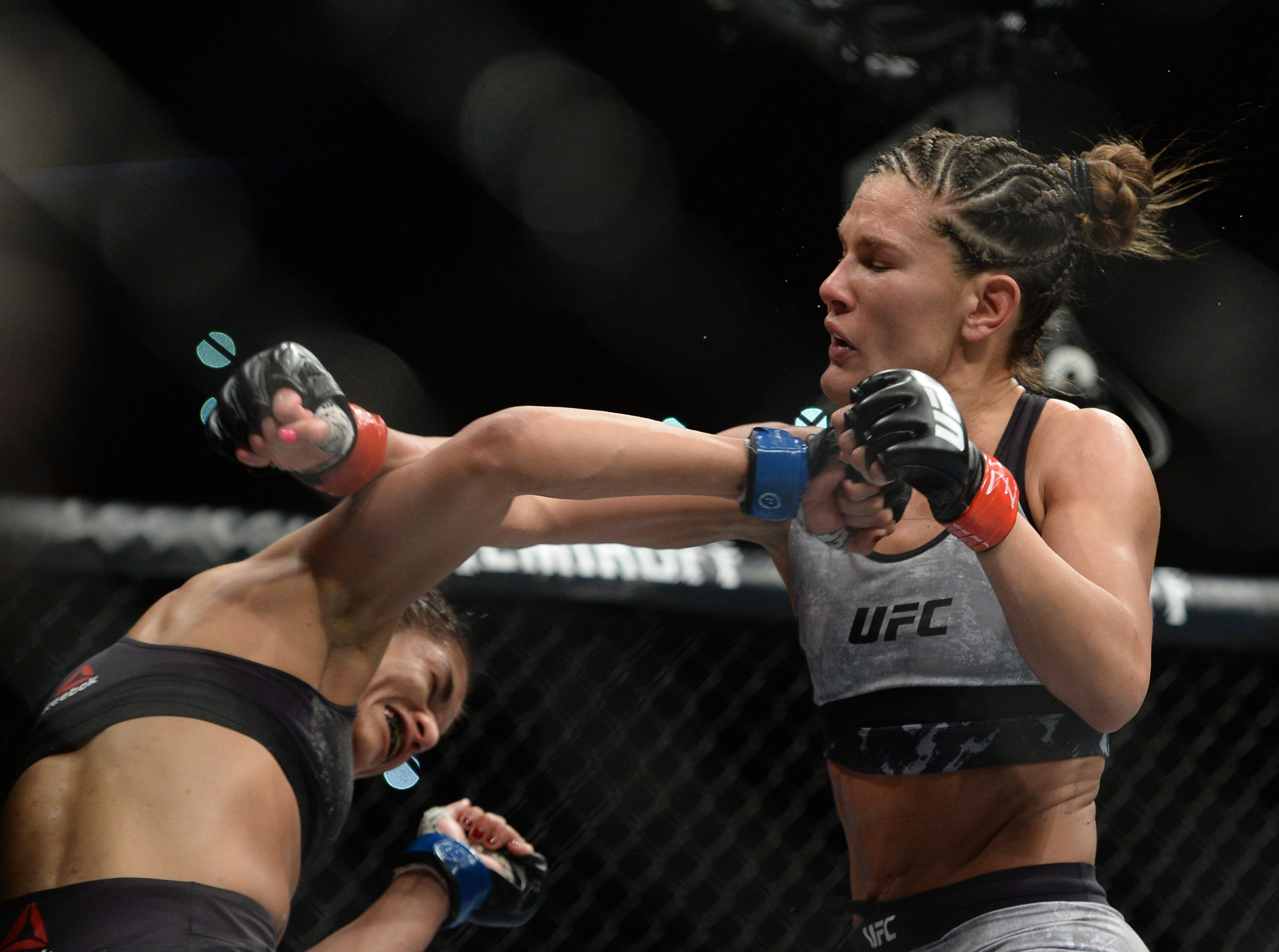 Cortney Casey swings on Cynthia Calvillo during their strawweight bout at UFC Fight Night at Talking Stick Resort Arena. Calvillo won by unanimous decision.