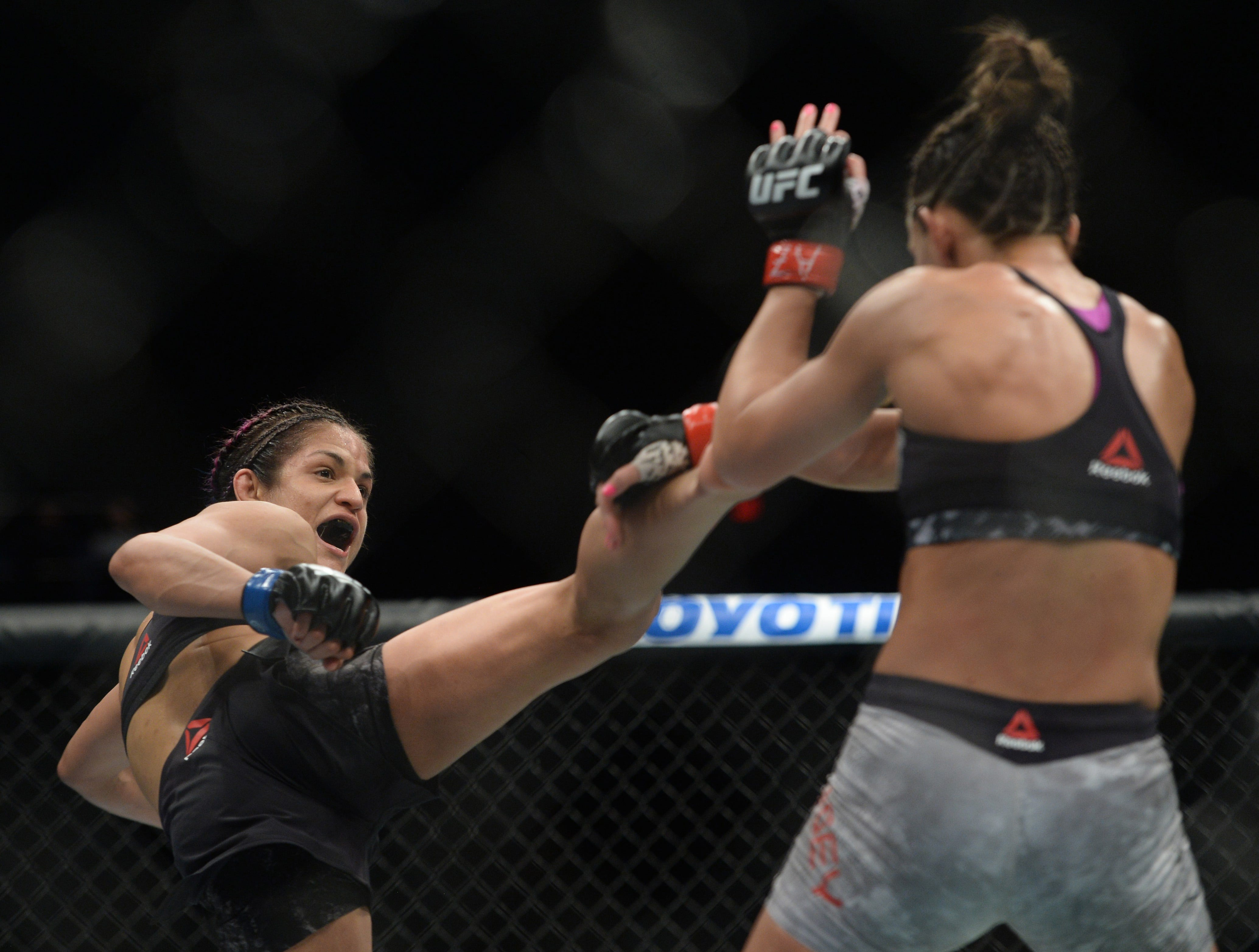 Cynthia Calvillo kicks Cortney Casey during their strawweight bout during UFC Fight Night at Talking Stick Resort Arena.
