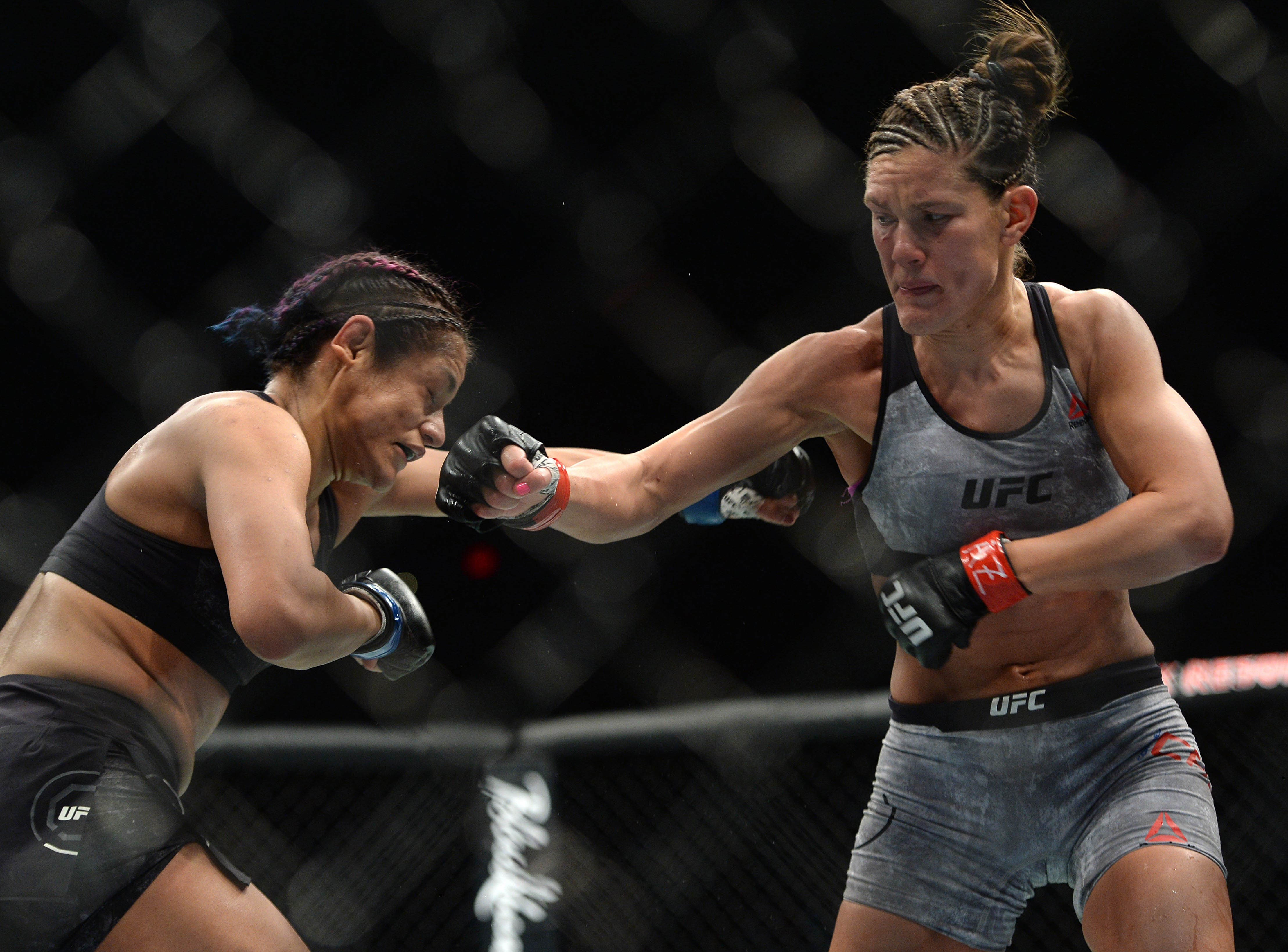 Cynthia Calvillo lands a body shot on Cortney Casey during fight at Talking Stick Resort Arena.
