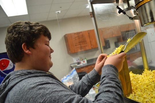 Seventh grader Bryce Brzeczek is dedicated to the school's popcorn fundraiser for Susie's Coats. He spends several evenings a month, as well as weekends during tournaments, making and bagging popcorn. He even came to school on a snow day to clean and prep the machine for the next sale.