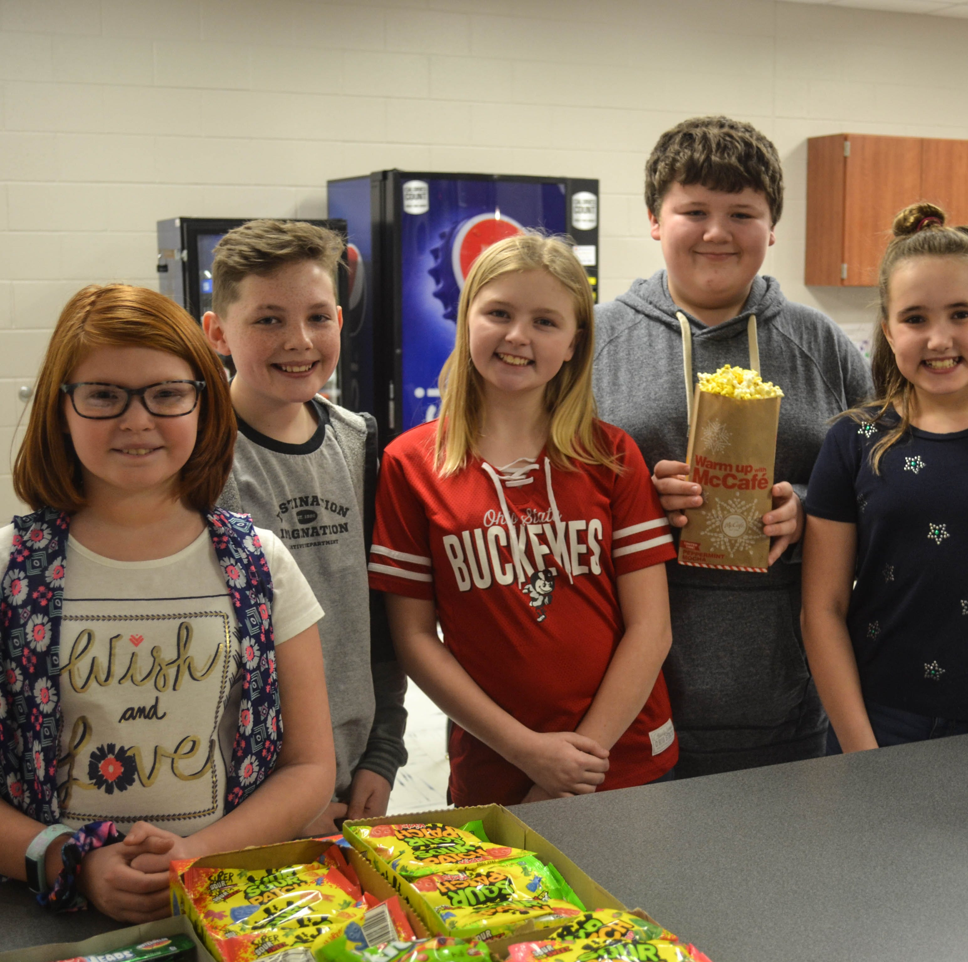 Middle school students turn popcorn sales into coats for needy