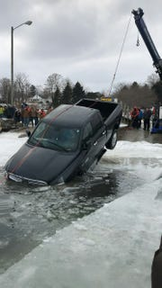 A truck was pulled from Lexington Harbor Sunday.