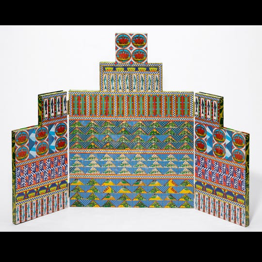 """Altarpiece,"" by Mary Ann Lomonaco, is  created from aluminum cans and bead embellishments."