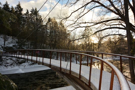 The first bridge over the Shepaug River on the Bee Brook trail is covered in snow and ice on a recent hike.
