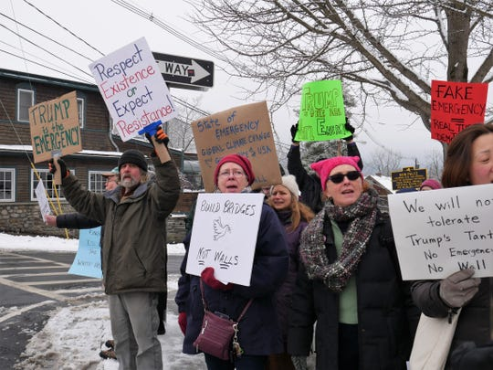 Protesters gather on the corners of Main and North Front streets in New Paltz on Feb. 18, 2019 to rally against President Donald Trump's national emergency declaration over the border wall.