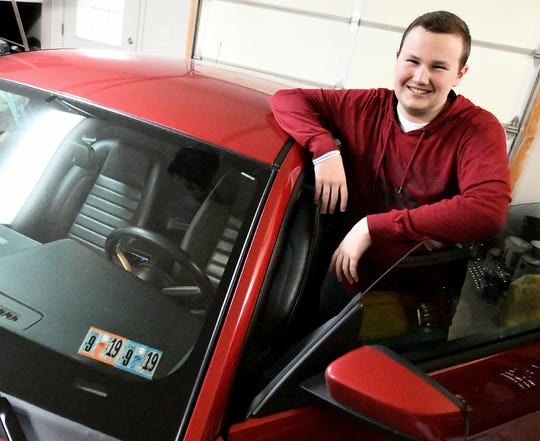 Ryan Dellinger poses with his 2010 Ford Mustang at his Hellam Township home Monday, Feb. 18, 2019. The teen was diagnosed last June with B cell acute lymphoblastic leukemia, a type of childhood cancer affecting the blood and bone marrow that increases in risk for children over the age of 10. Bill Kalina photo