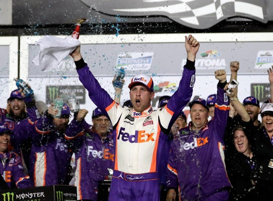 Denny Hamlin celebrates in Victory Lane after winning the NASCAR Daytona 500 auto race at Daytona International Speedway, Sunday, Feb. 17, 2019, in Daytona Beach, Fla. (AP Photo/John Raoux)