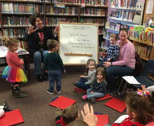 Felicia Gettle conducts a story time for children at Kreutz Creek Library.