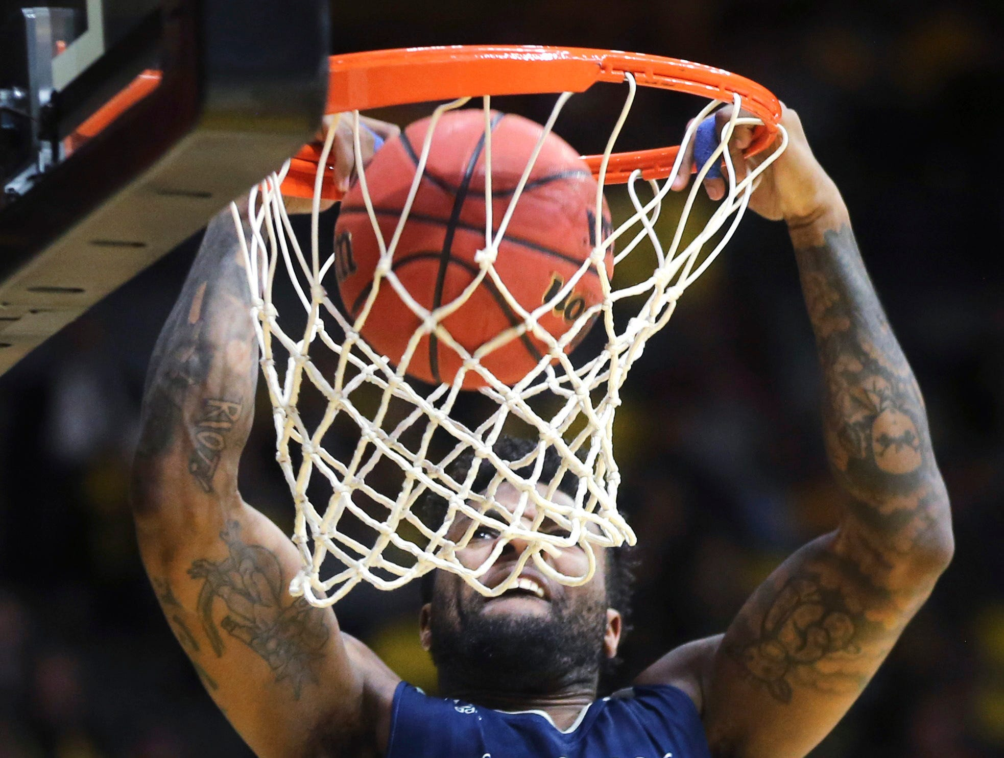 Nevada guard Jordan Caroline dunks during the first half of the team's basketball game against Wyoming on Saturday in Laramie, Wyo.