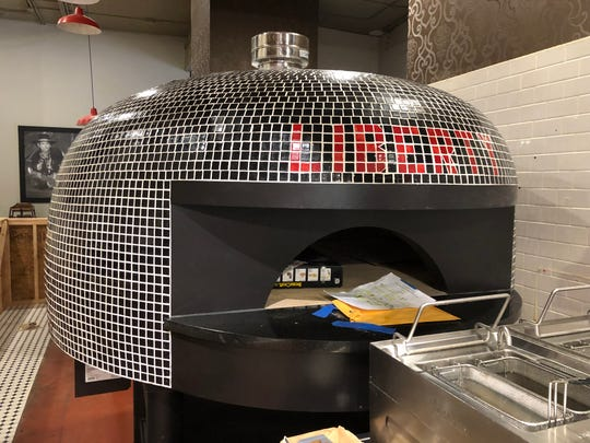 A Marra Forni two-mouthed wood-fire oven is part of the major kitchen improvements at Liberty Food & Wine Exchange.