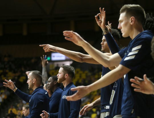 The Nevada bench reacts to a score during the second half against Wyoming on Saturday in Laramie, Wyo.