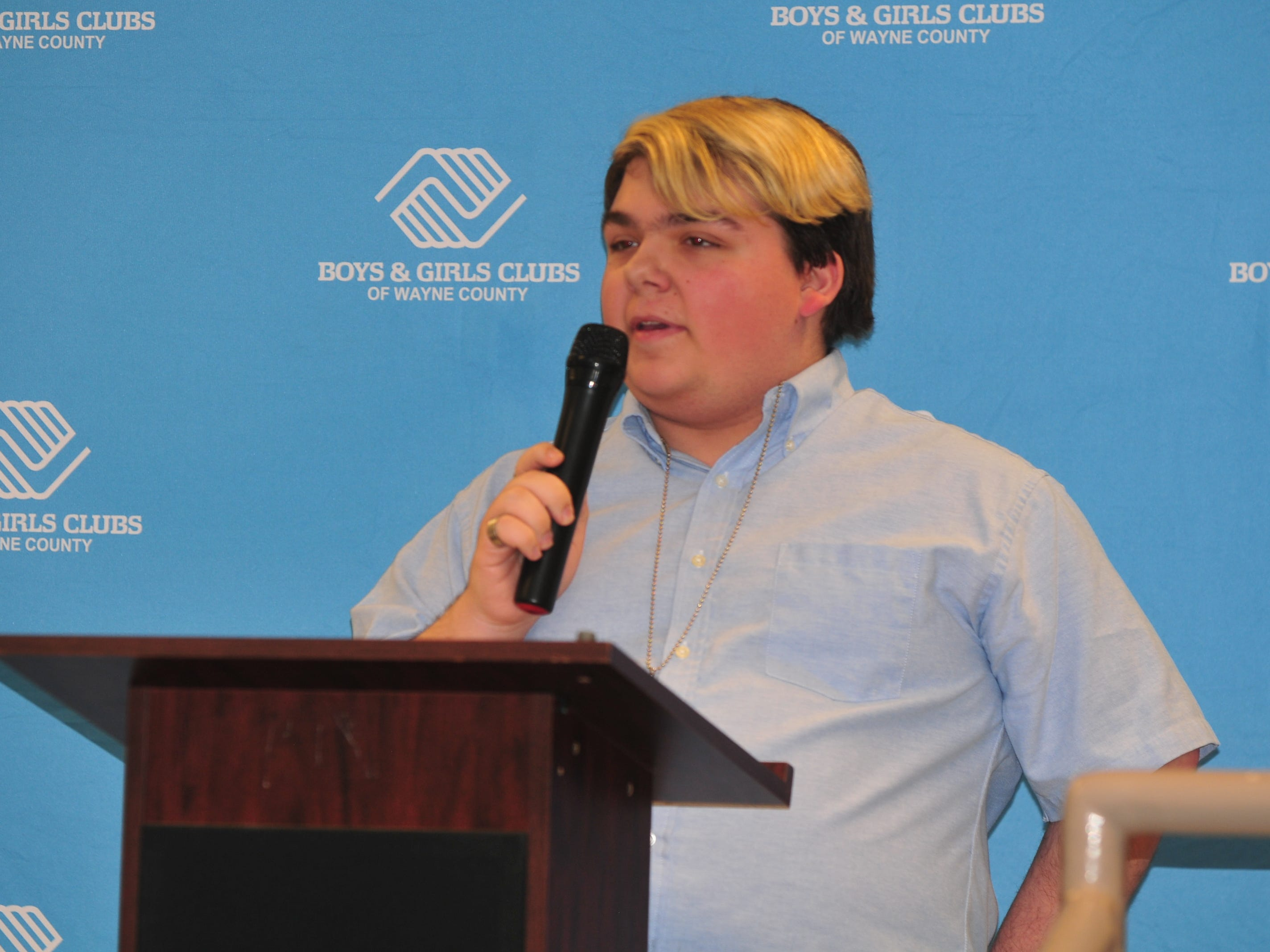 Mikey Martin presents his essay Monday during the Boys and Girls Clubs of Wayne County Youth of the Year competition at the Jeffers Unit.