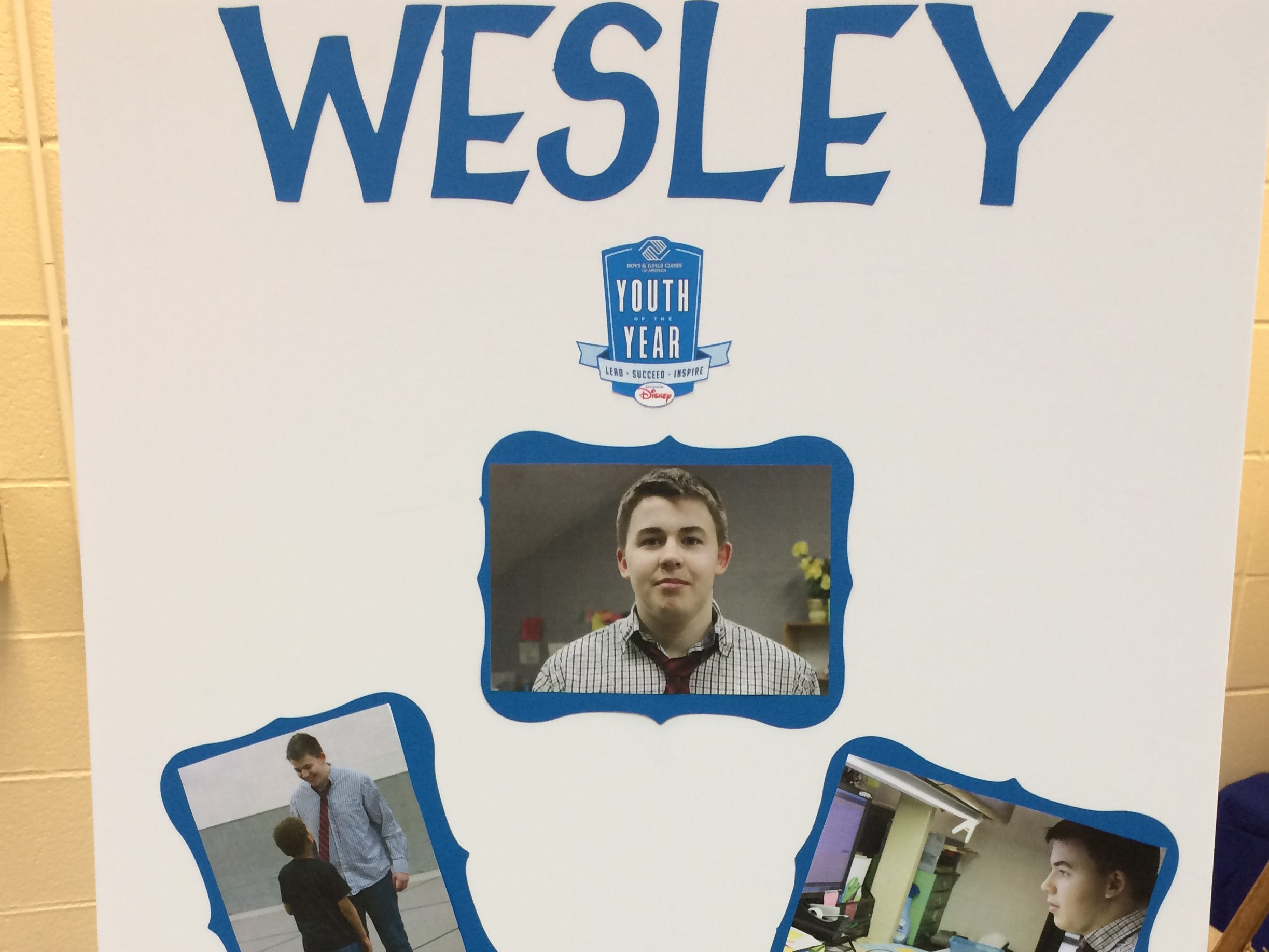 A poster represents Wesley Phillips during the Boys and Girls Clubs of Wayne County Youth of the Year competition at the Jeffers Unit.