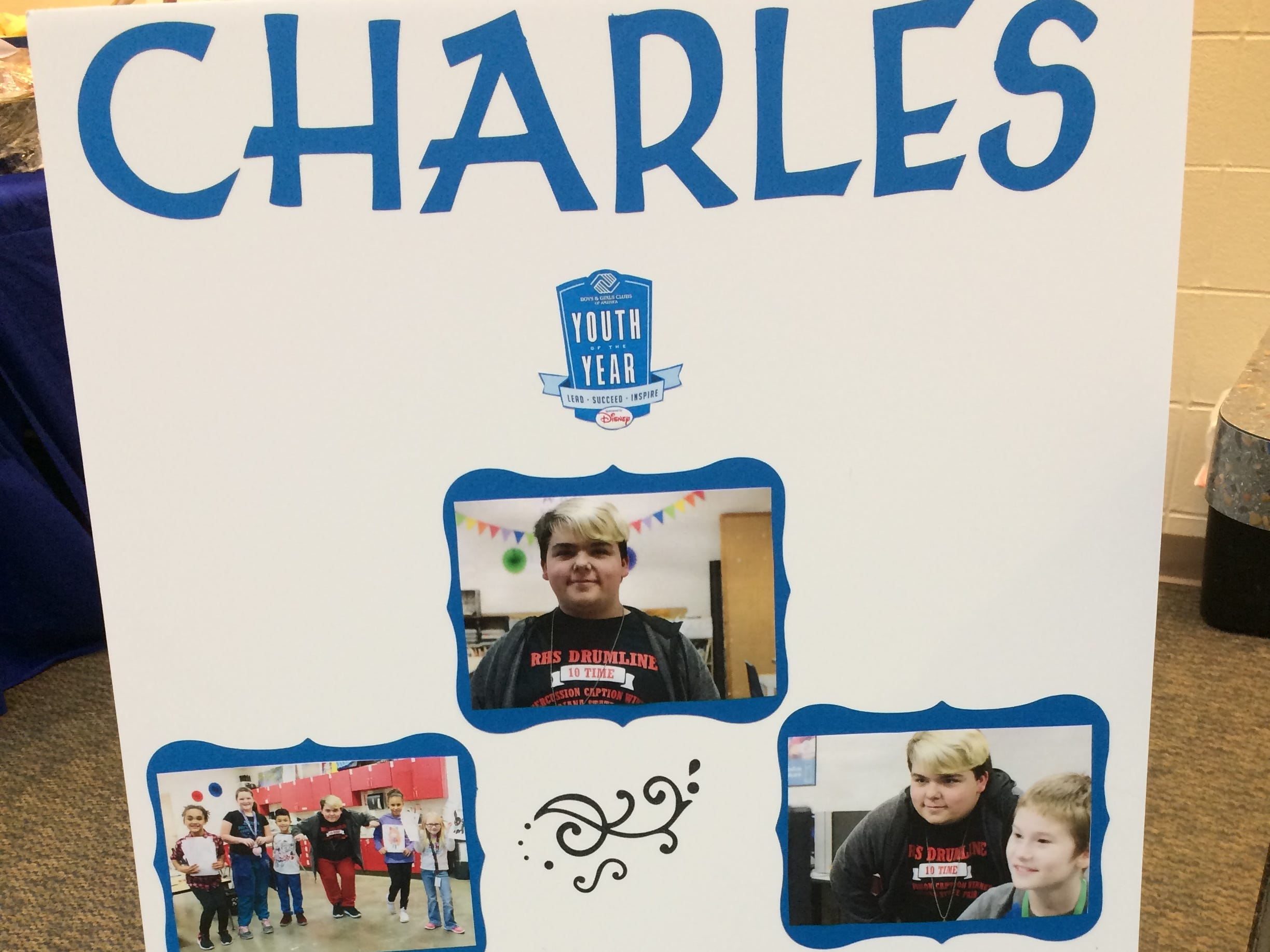 A poster represents Mikey Martin, whose given name is Charles, during the Boys and Girls Clubs of Wayne County Youth of the Year competition at the Jeffers Unit.