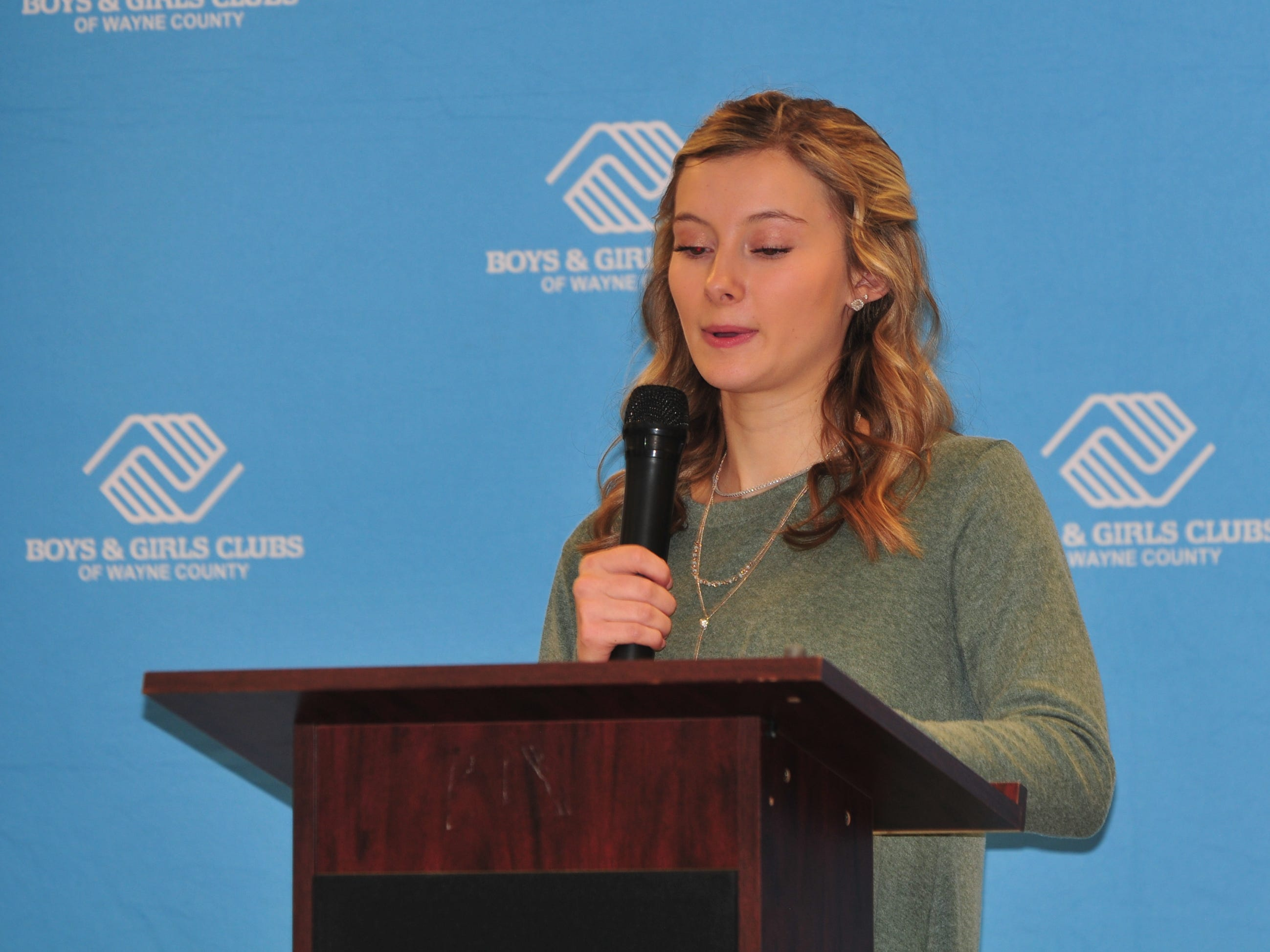 Kaitlyn Tracy, the Boys and Girls Clubs of Wayne County 2018 Youth of the Year, reads the Club Creed on Monday.