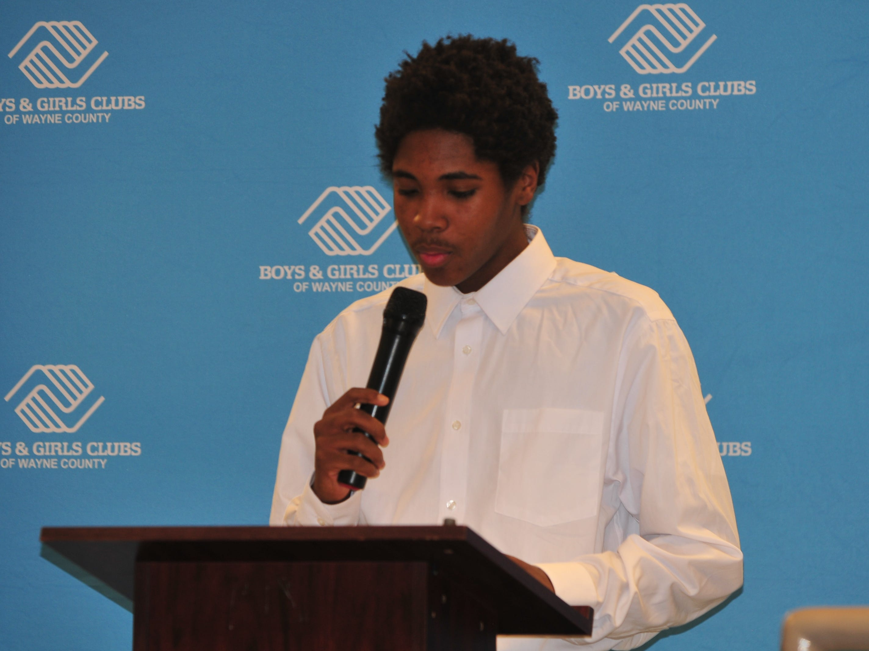 Isayah Wilks presents hisr essay Monday during the Boys and Girls Clubs of Wayne County Youth of the Year competition at the Jeffers Unit.