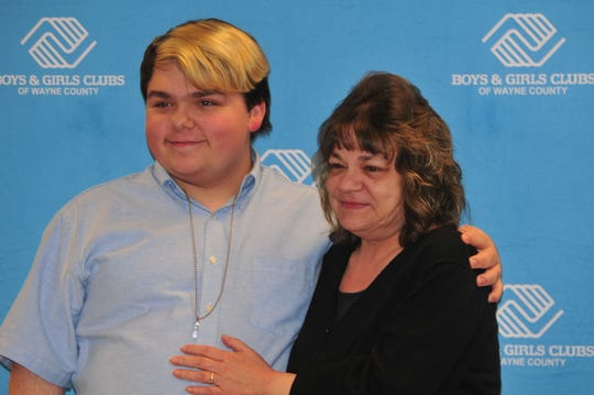 Mikey Martin poses with his mother, Kay Martin, after he was named Youth of the Year for the Boys and Girls Clubs of Wayne County.