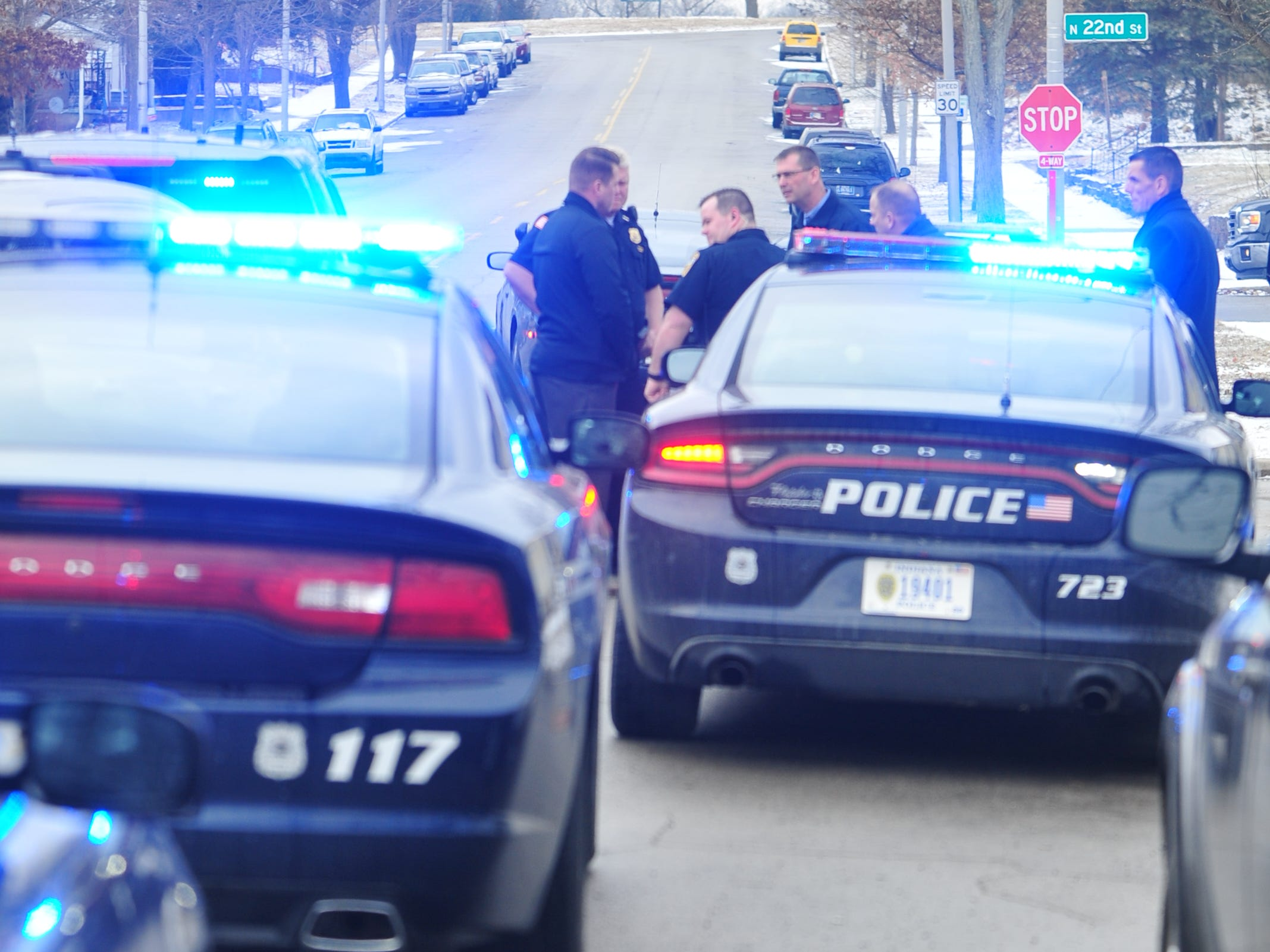 Richmond Police Department personnel investigates a shooting Monday in the 2100 block of Grand Boulevard. One victim was transported to Reid Health.