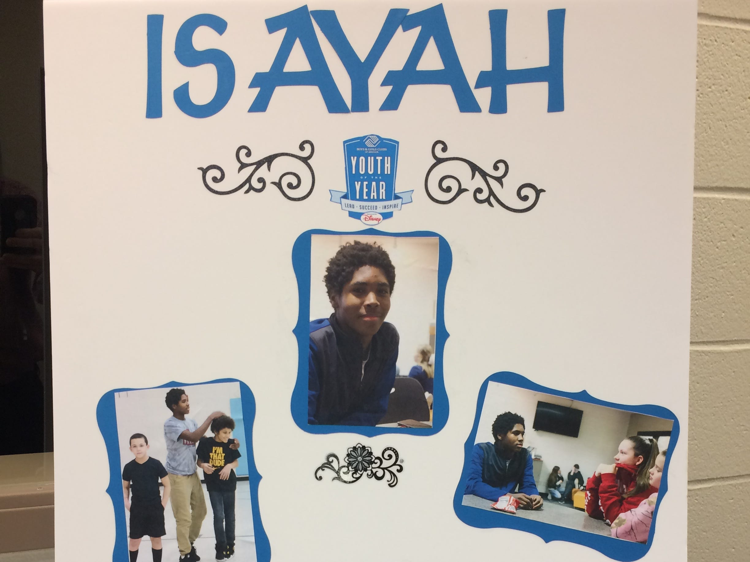 A poster represents Isayah Wilks during the Boys and Girls Clubs of Wayne County Youth of the Year competition at the Jeffers Unit.