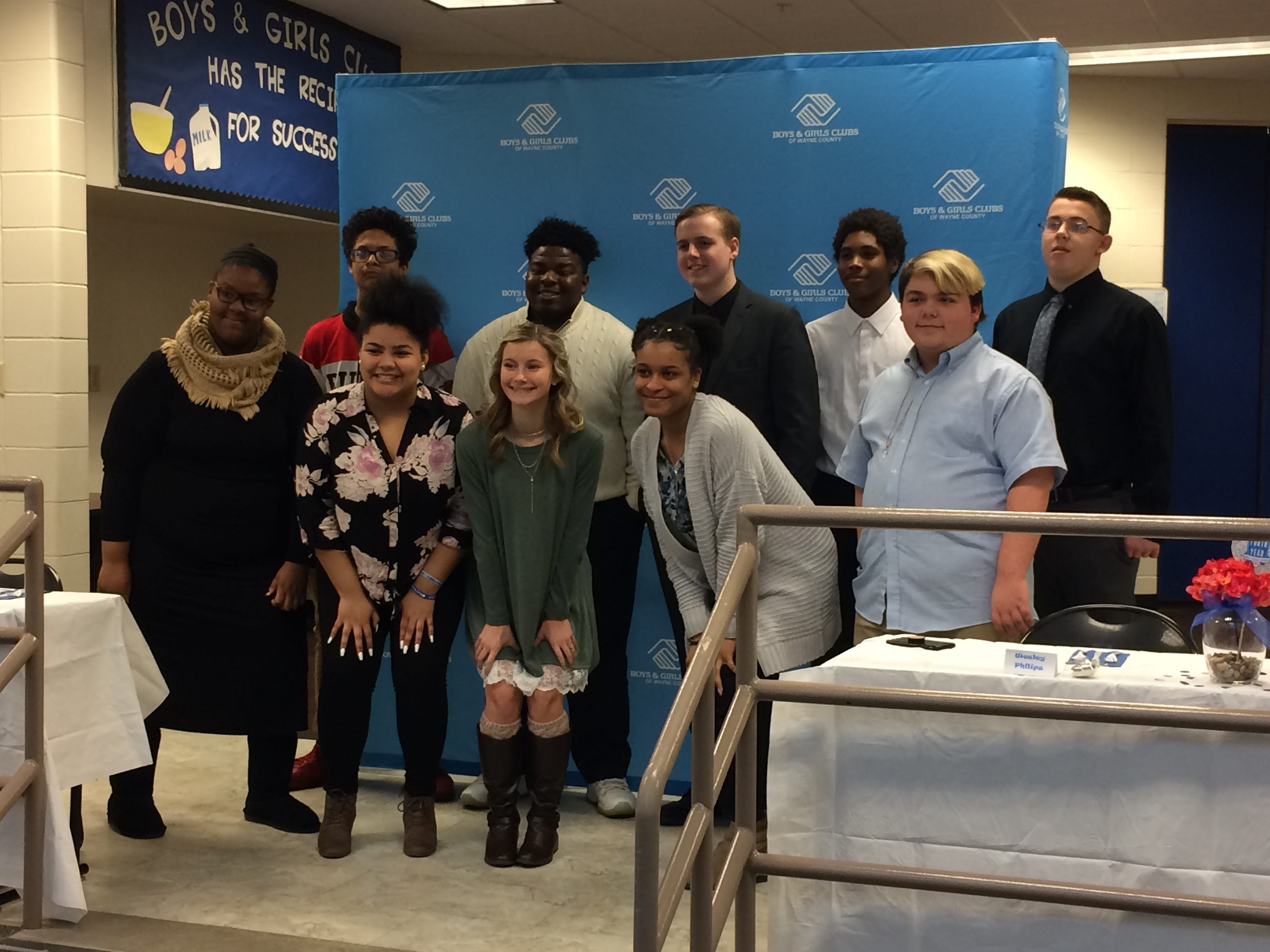 The nine 2019 candidates for Youth of the Year pose with 2018 Youth of the Year winner Kaitlyn Tracy.