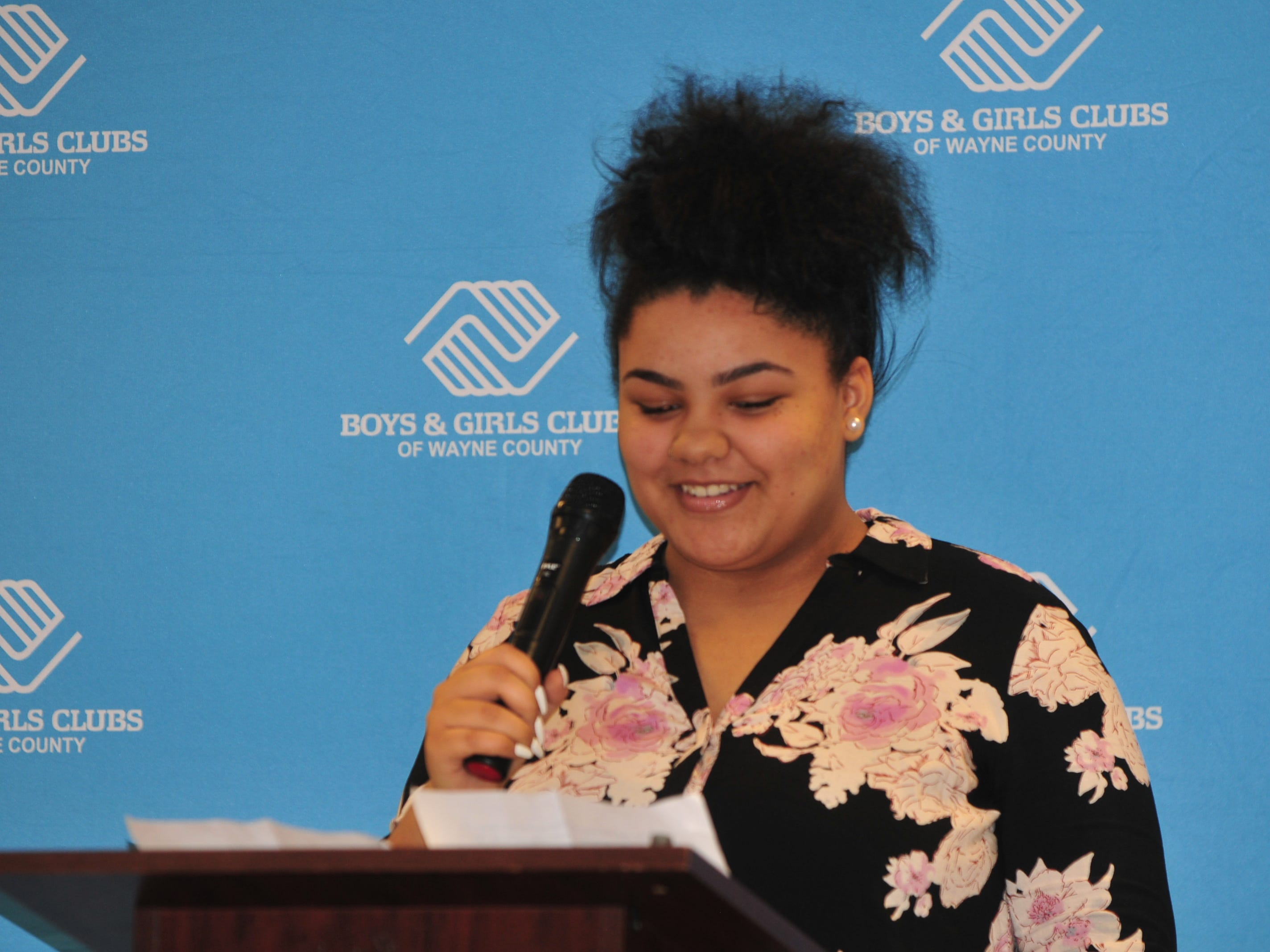 Natalia Hampton presents her essay Monday during the Boys and Girls Clubs of Wayne County Youth of the Year competition at the Jeffers Unit.