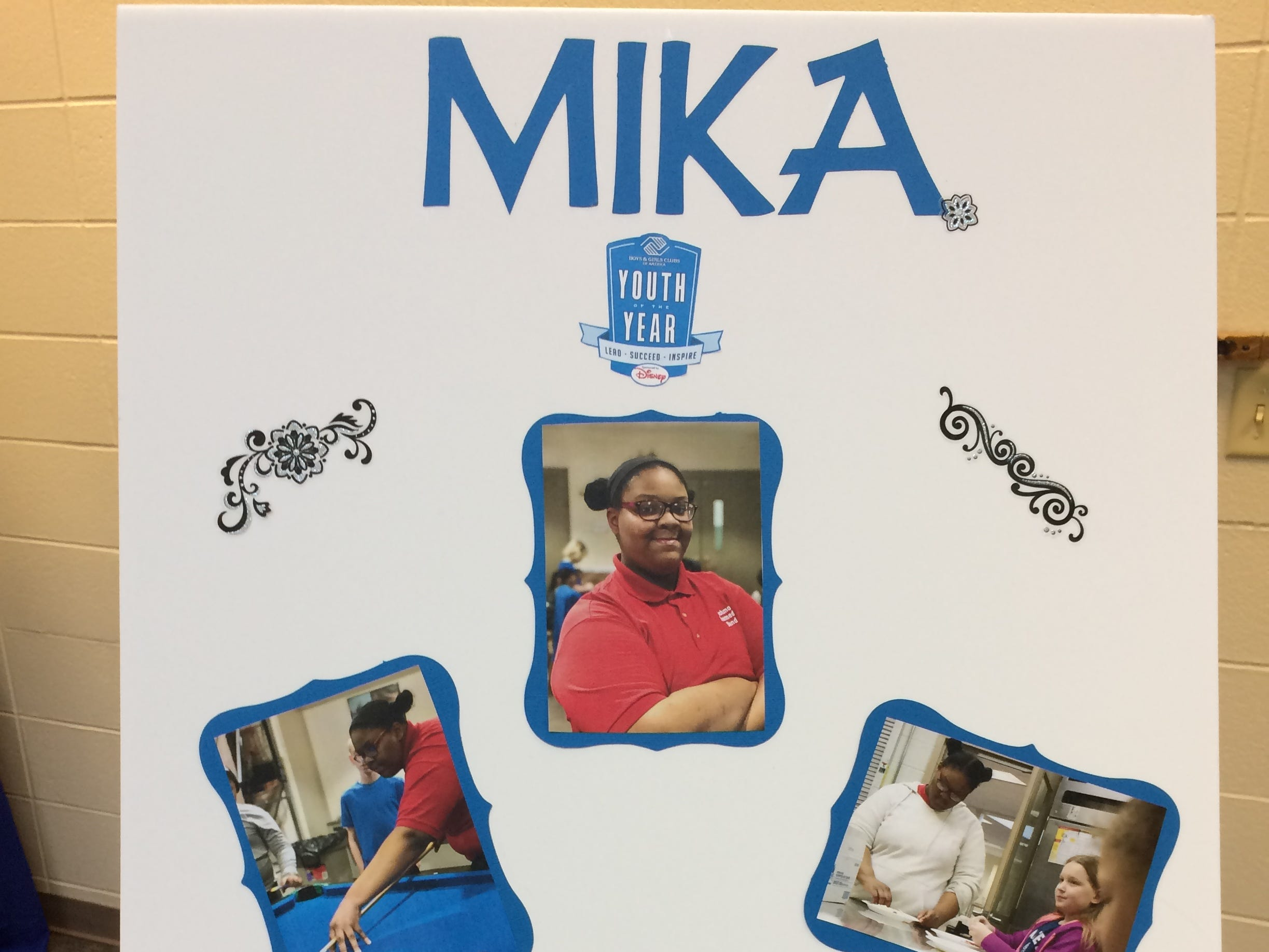 A poster represents Mika Parks during the Boys and Girls Clubs of Wayne County Youth of the Year competition at the Jeffers Unit.