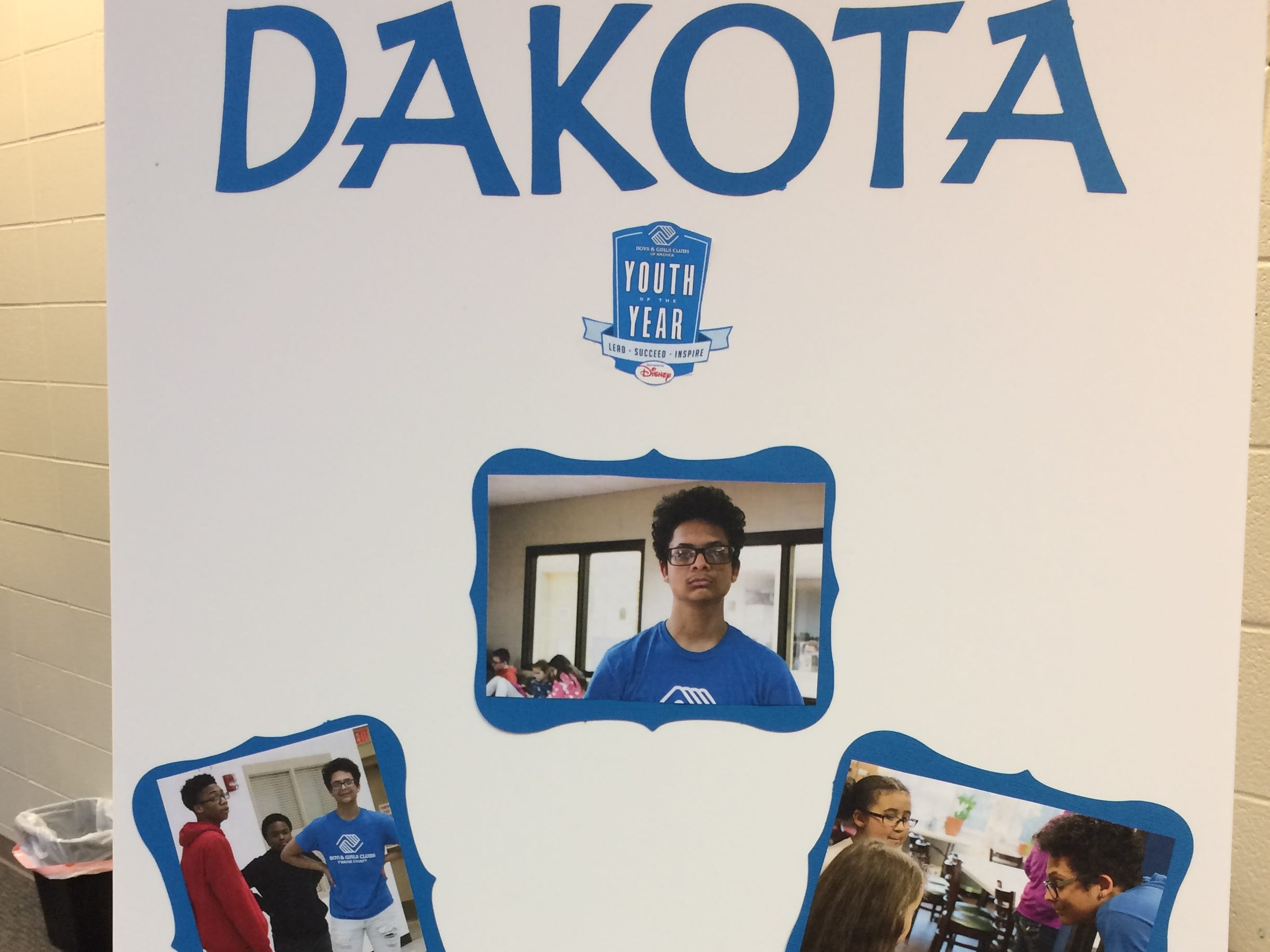 A poster represents Dakota Mitchell during the Boys and Girls Clubs of Wayne County Youth of the Year competition at the Jeffers Unit.