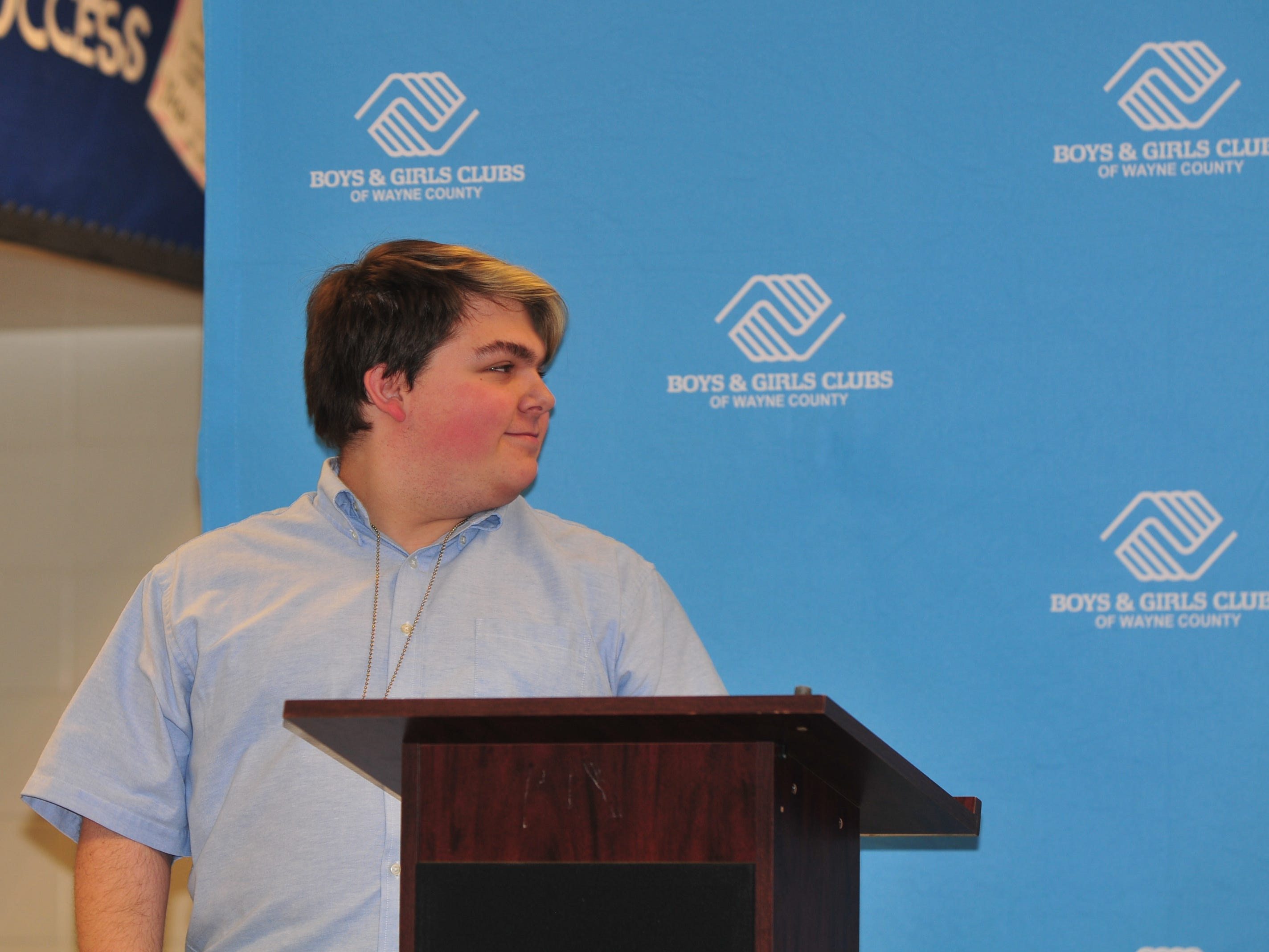 Mikey Martin reacts after learning he was chosen the Youth of the Year for the Boy and Girls Clubs of Wayne County.