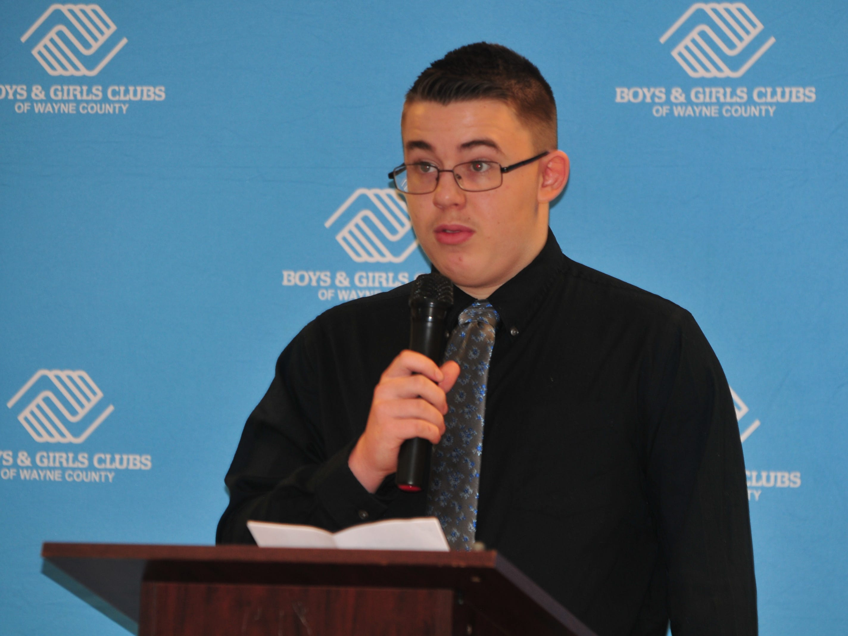 Wesley Phillips presents his essay Monday during the Boys and Girls Clubs of Wayne County Youth of the Year competition at the Jeffers Unit.