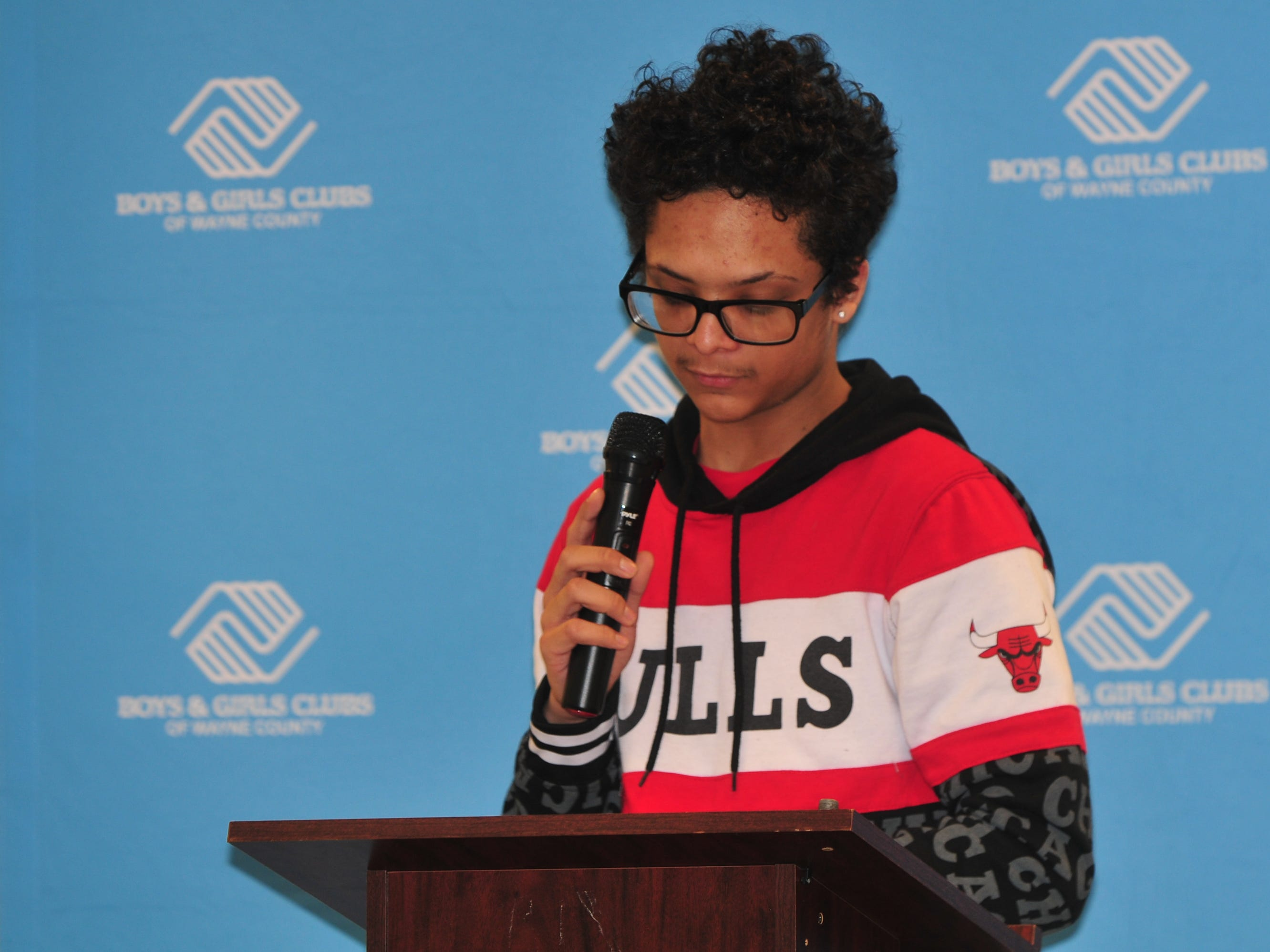 Dakota Mitchell presents his essay Monday during the Boys and Girls Clubs of Wayne County Youth of the Year competition at the Jeffers Unit.