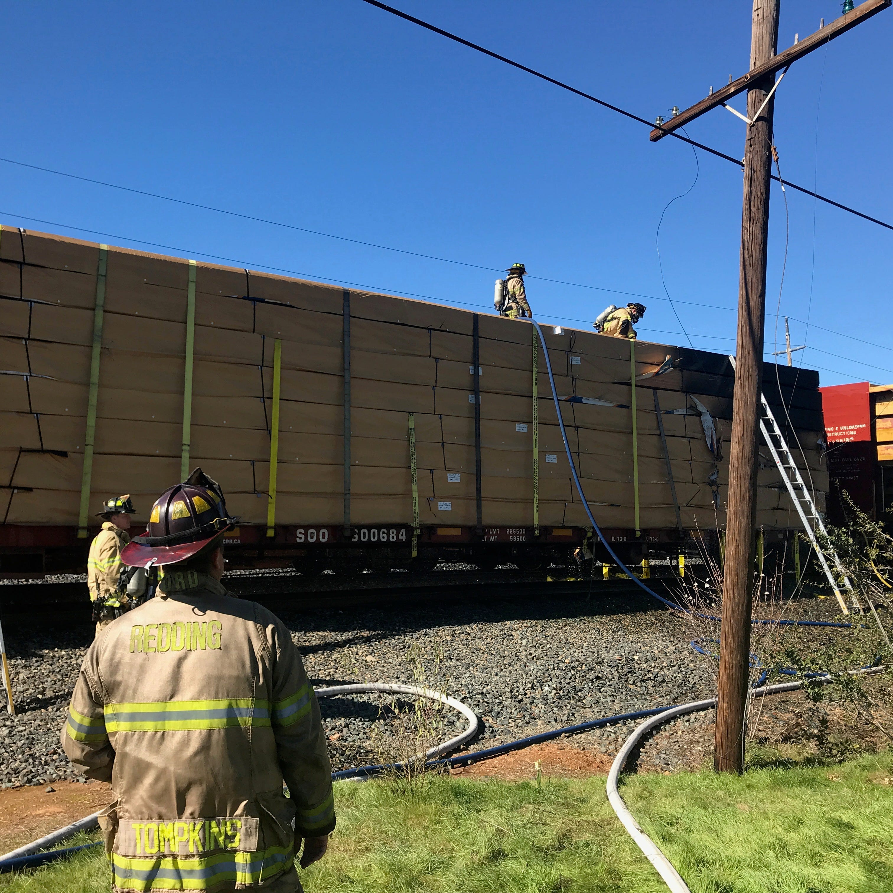 UPDATE: Flatcar filled with wood laminate catches fire in south Redding
