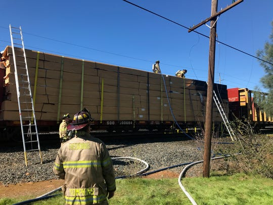 Redding firefighters knock down a fire that broke out on a boxcar Monday, Feb. 18, 2019. The train was stopped just east of the Martin Luther King Jr. neighborhood.