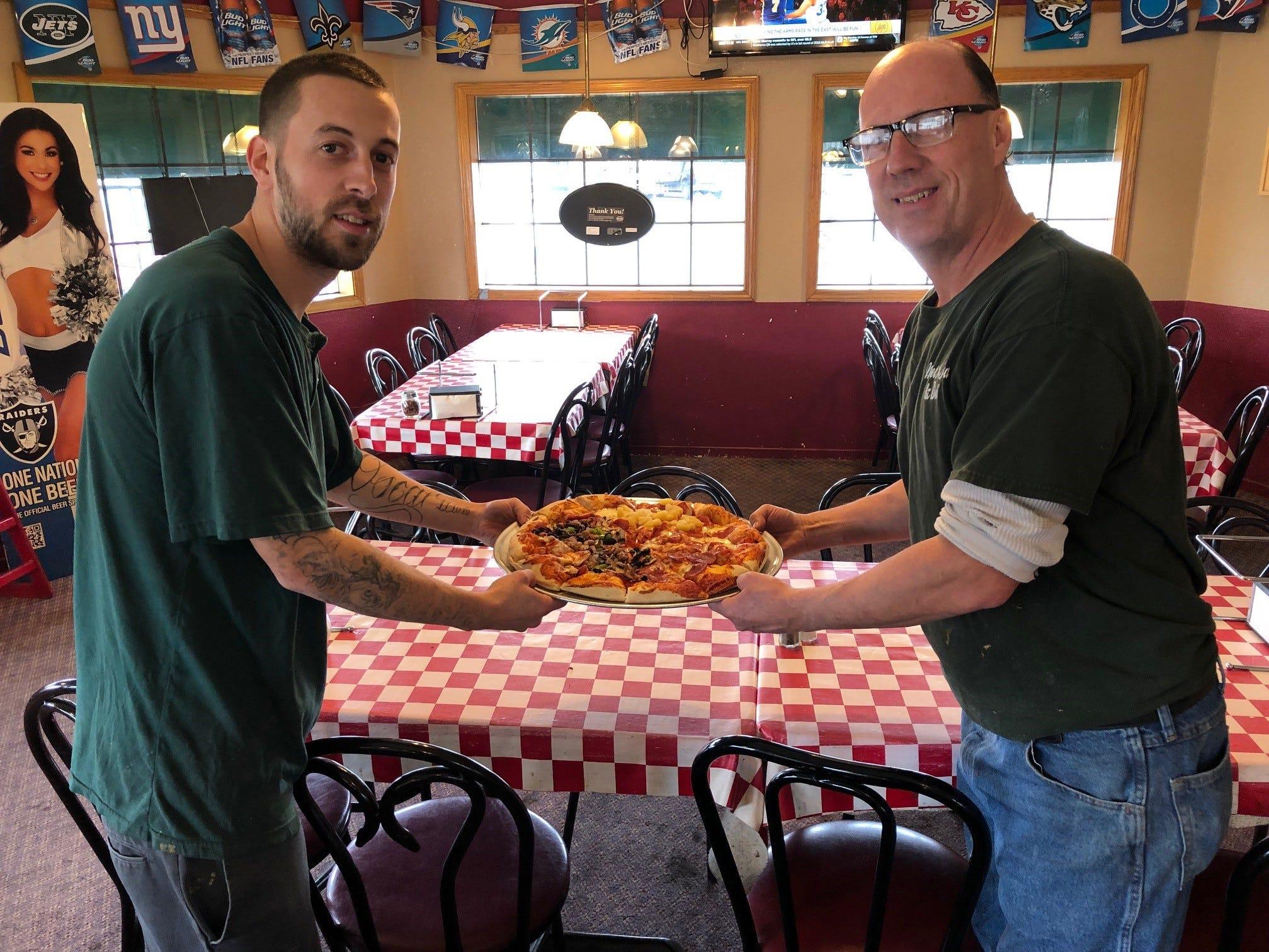 Market Street Pizza co-owner Tony Trapozzano, right, with son Brandon.