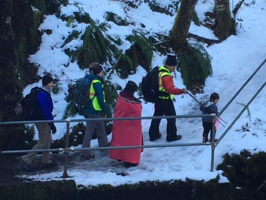 A woman and her child are escorted out of the Perimeter Trail at Silver Falls State Park Monday, Feb. 18, 2019.
