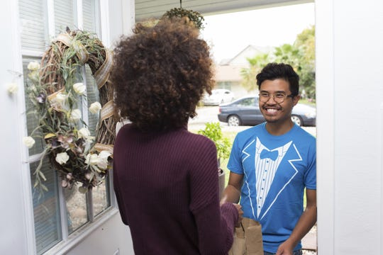 A Favor runner delivers an order to a customer.