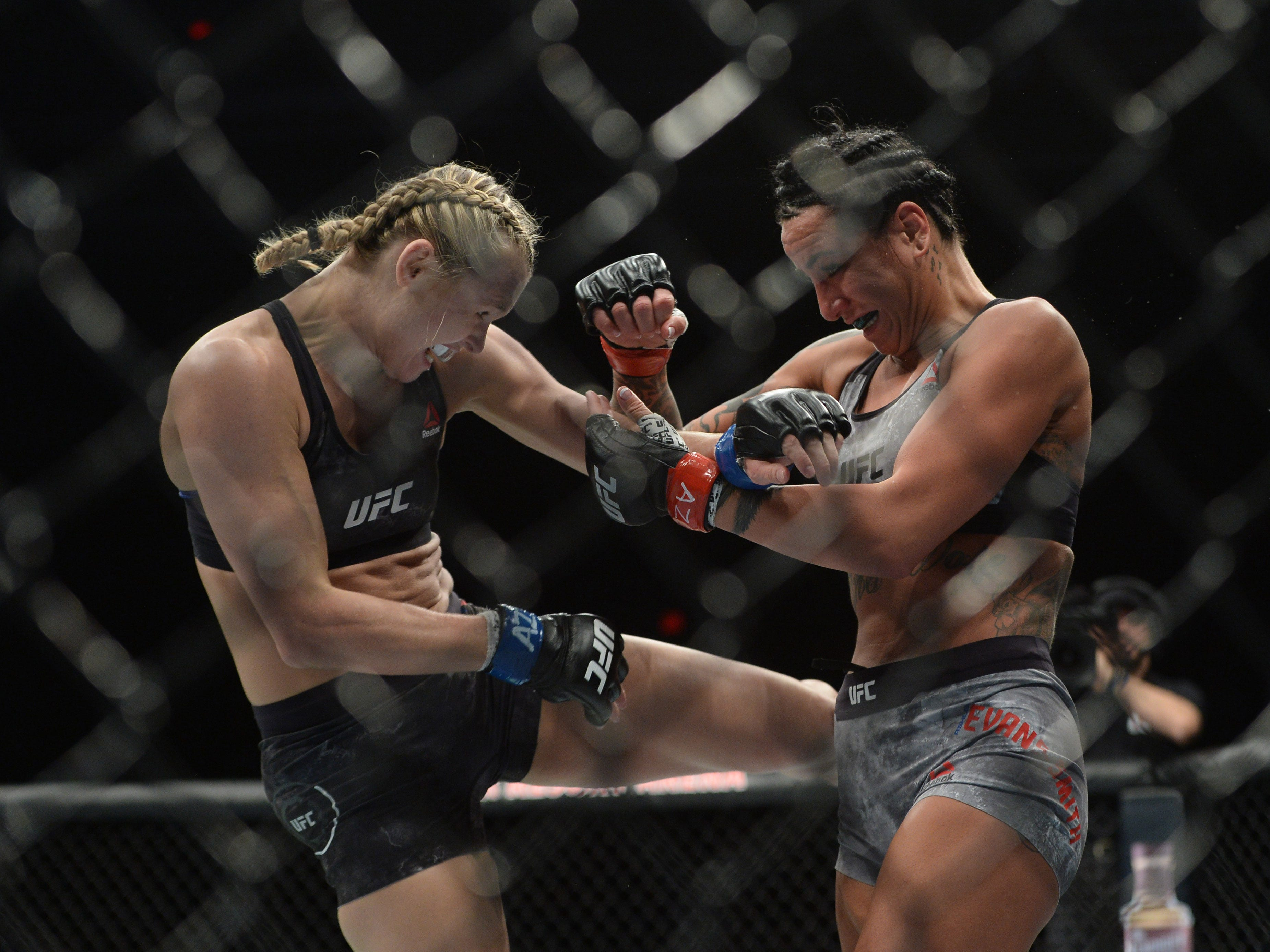 Feb 17, 2019; Phoenix, AZ, USA; Ashlee Evans-Smith (red gloves) and Andrea Lee (blue gloves) fight during their flyweight bout during UFC Fight Night at Talking Stick Resort Arena. Lee won via decision. Mandatory Credit: Joe Camporeale-USA TODAY Sports