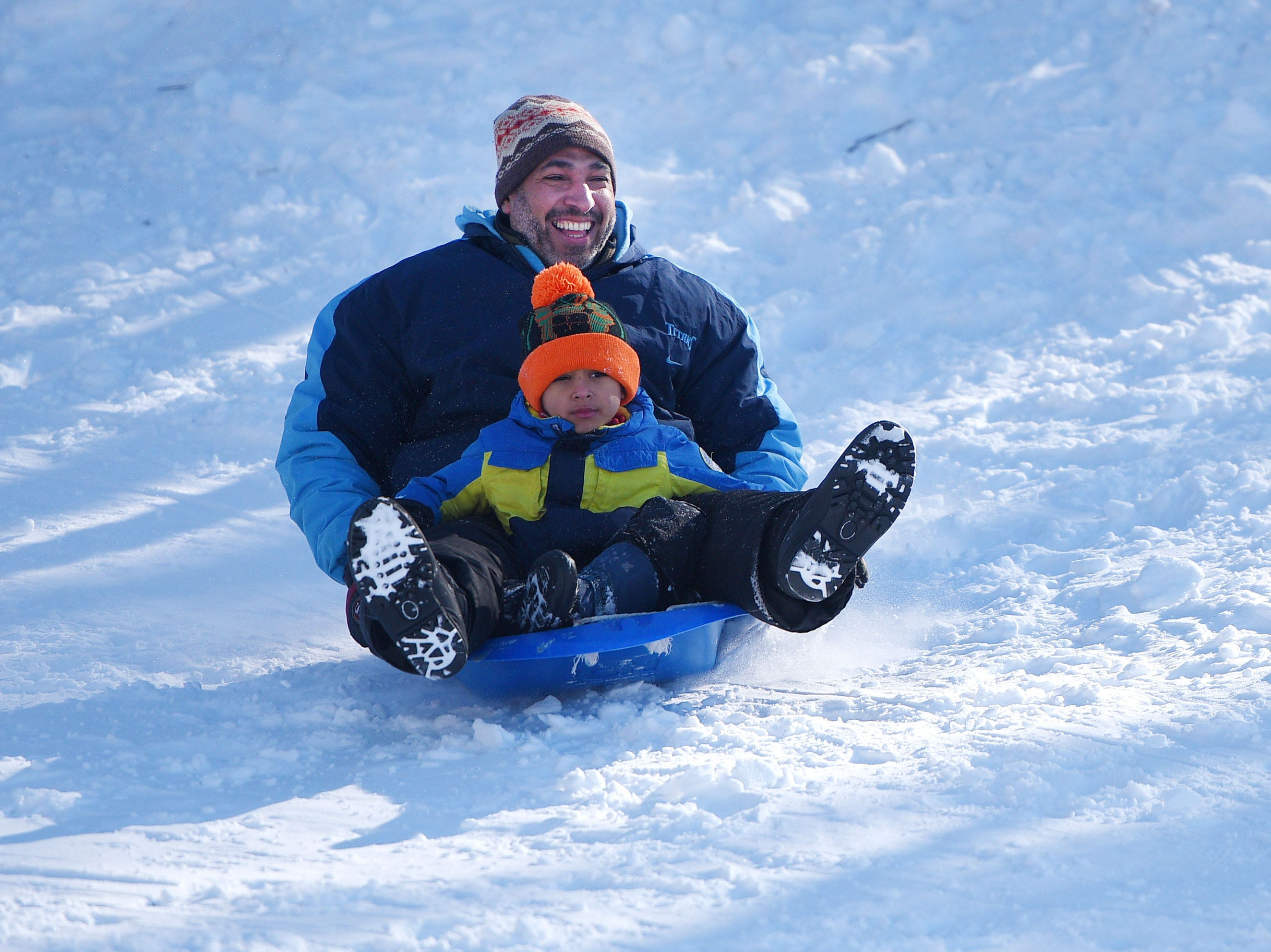 Shamkhi Alkutayfi and his son Hassan Alkutayfi go sledding at Tuthill Park Monday, Feb. 18, in Sioux Falls.