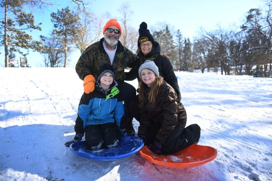 Greg and Dianne Rerick go sledding with their grandchildren Preston and Payge at Tuthill Park Monday, Feb. 18, in Sioux Falls. Greg and Dianne said they grew up sledding at Tuthill. Now they share that experience with their grandchildren.