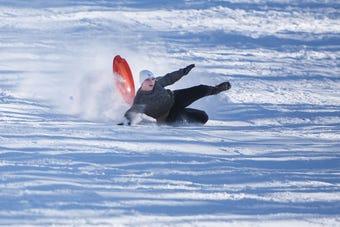 Argus Leader reporter Makenzie Huber goes sledding Monday, Feb. 18, in Sioux Falls.