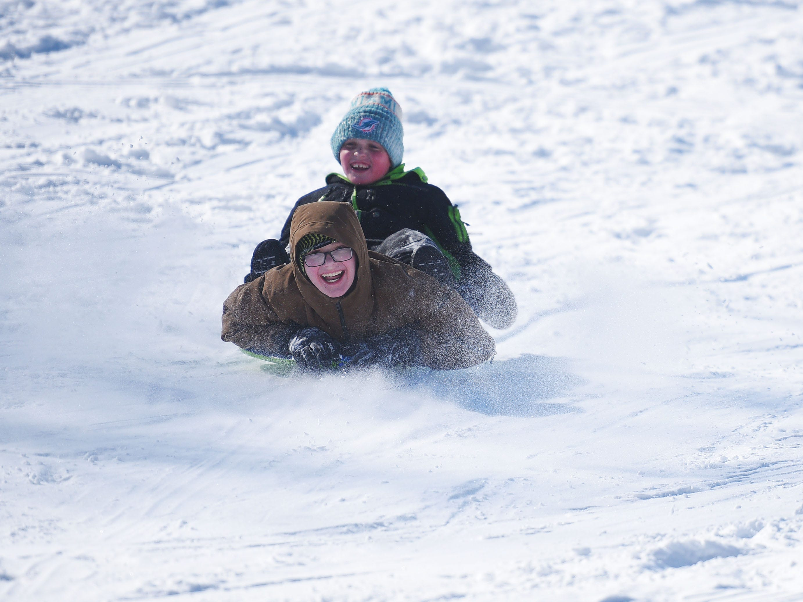 Arvid Nelsen and Tysen Ulmer go sledding at Tuthill Park Monday, Feb. 18, in Sioux Falls.
