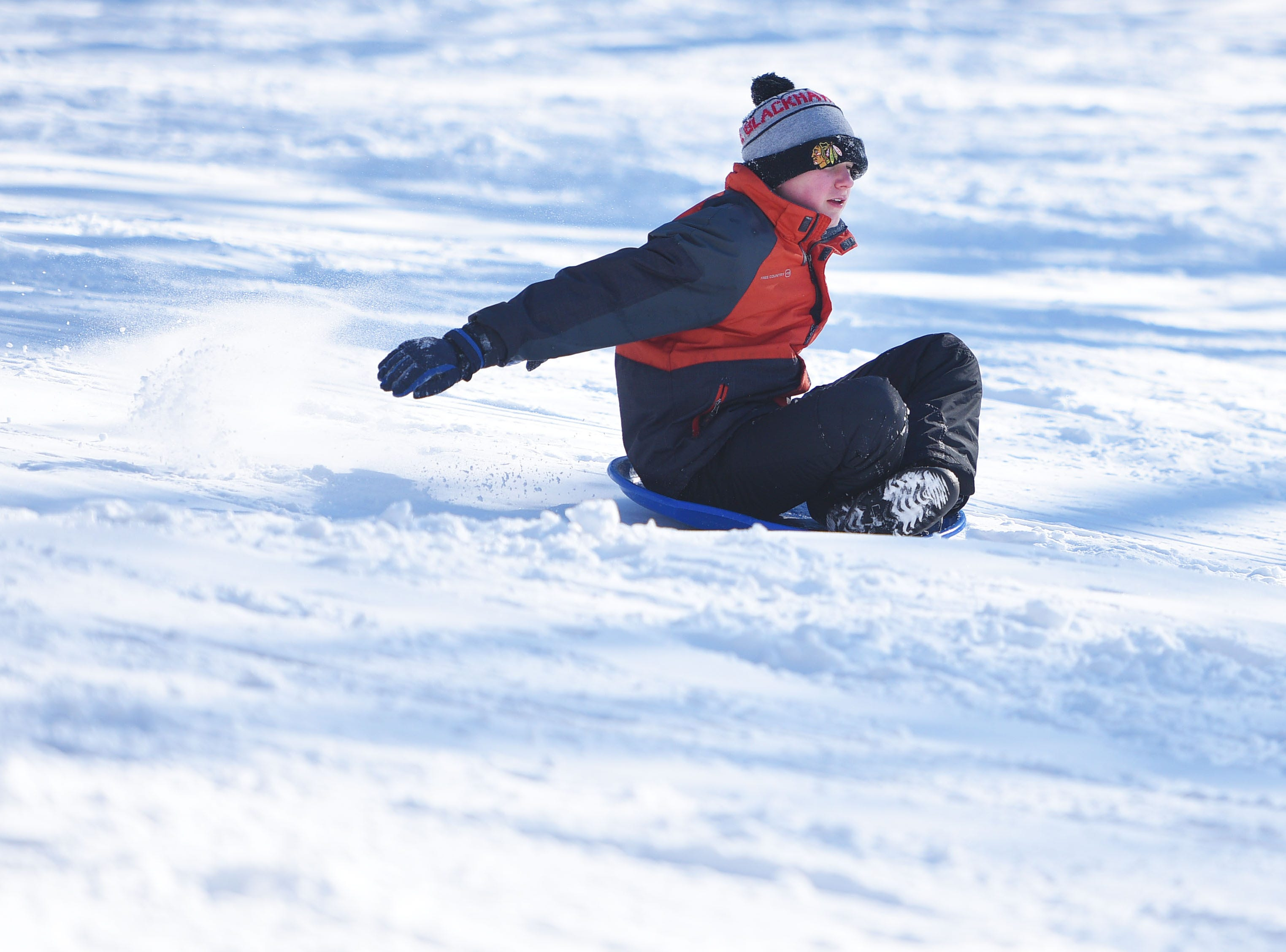 Kanton Decker goes sledding at Tuthill Park Monday, Feb. 18, in Sioux Falls.