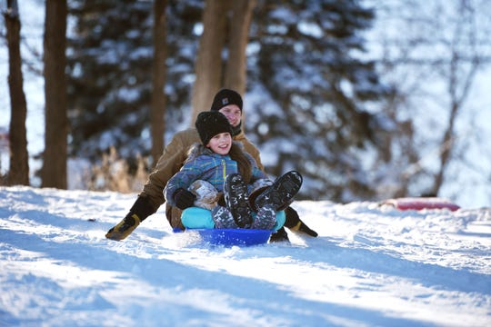 Jason Wallen goes sledding with his daughter Jaida at Leaders Park Monday, Feb. 18, in Sioux Falls.