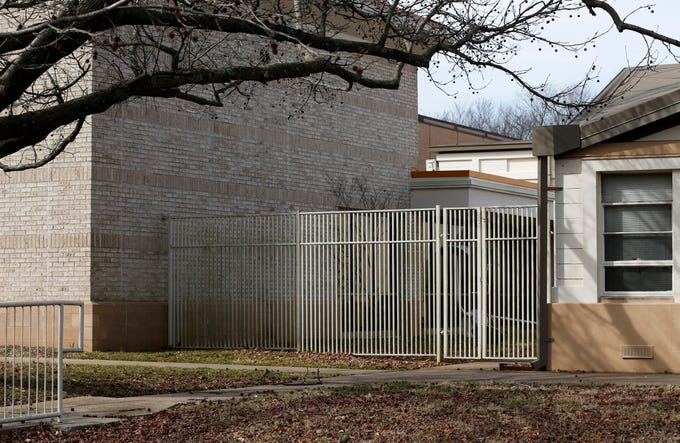 The gate to the courtyard at the Springfield Art Museum where robbers entered the museum and stole seven Warhol screenprints in 2016.