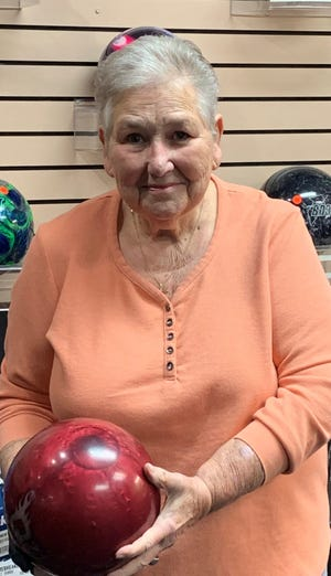 Karen Foss poses at Sunset Lanes after rolling a season-high 582 series that includes 13 strikes.