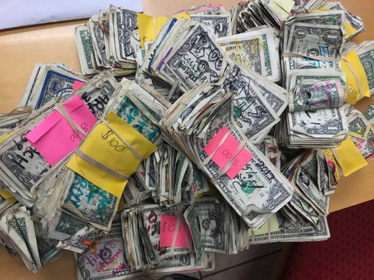 Dollar bills, $3417 worth, taken down off the walls of the St. George Island bar Harry A's were donated to the Franklin County Humane Society last week.